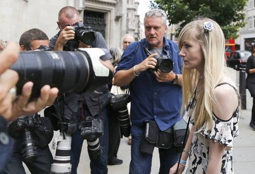 Connie Yates, mother of critically ill baby Charlie Gard arrives at the Royal Court of Justice in London, Tuesday, July 25, 2017. Lawyers for the family of critically ill infant Charlie Gard and the hospital treating him were returning to court for a hearing Tuesday, a day after the baby's parents said they were dropping their long legal battle to get him experimental treatment. The subject of Tuesday's hearing at the High Court in London was not immediately clear. (AP Photo/Frank Augstein)