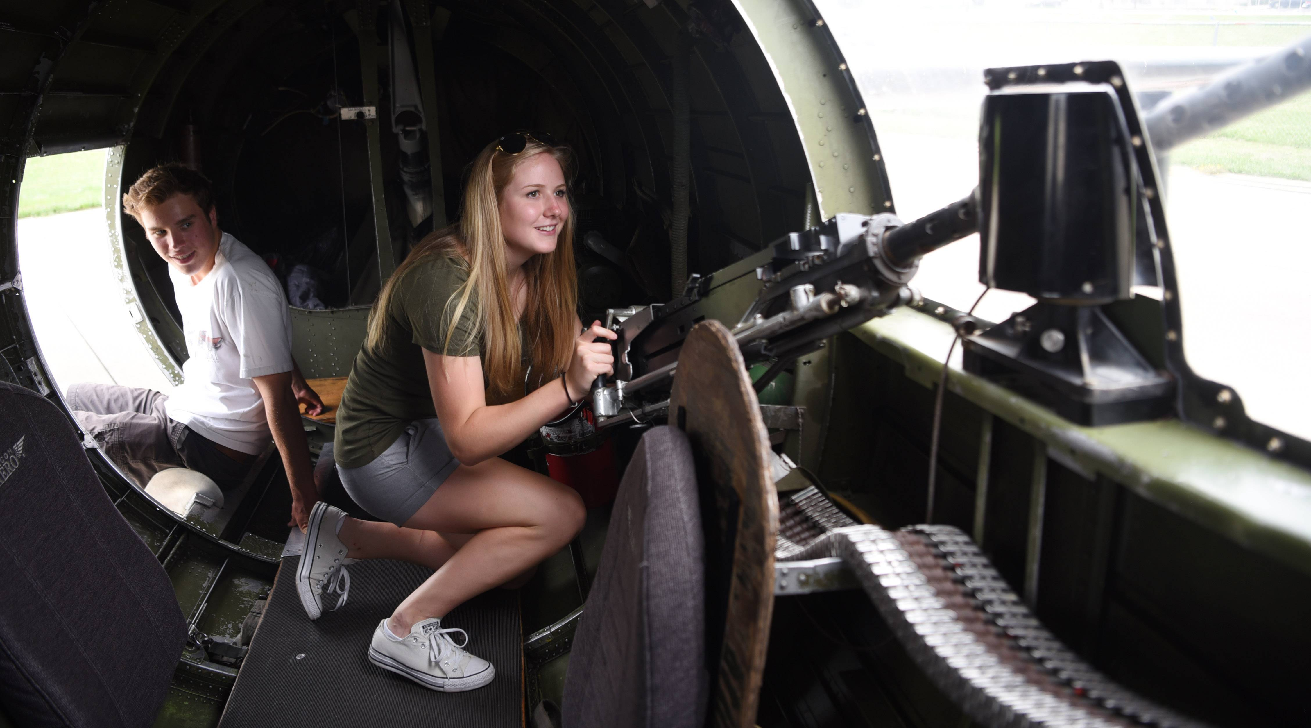Layne Lindroth, right, and Owen Risop, both of Barrington, view the interior of a B-17 Flying Fortress, a World War II-era bomber, during the Wings of Freedom tour at Chicago Executive Airport in Wheeling Wednesday.