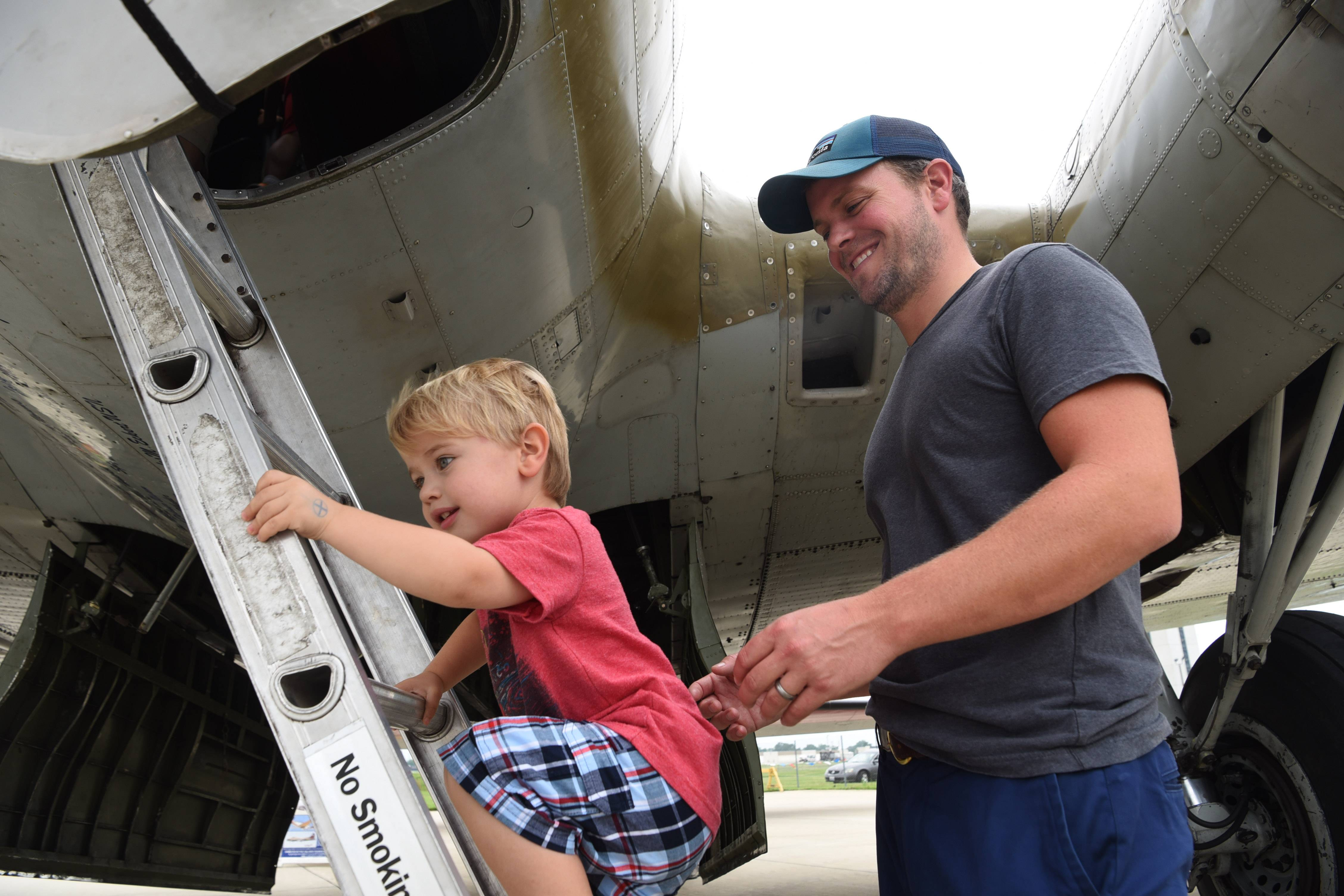 Hunter Galbraith, 2, of Northfield, climbs into a B-17 Flying Fortress while he and his dad, Ian, visit the Wings of Freedom tour at Chicago Executive Airport in Wheeling Wednesday.