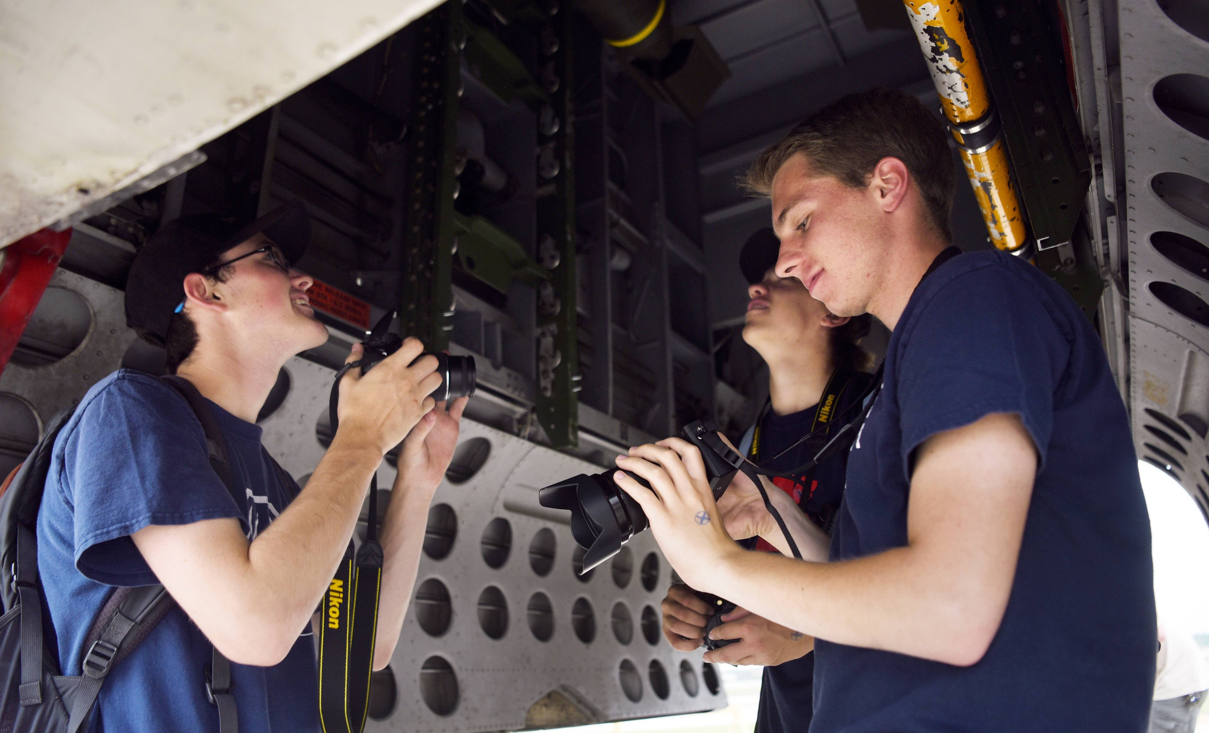 Left to right, Kyle Krinninger, Dave Zeman, and Ryan Heuer, all of Arlington Heights, view the bomb bay of a B-25 Mitchell during the Wings of Freedom tour at Chicago Executive Airport in Wheeling Wednesday.