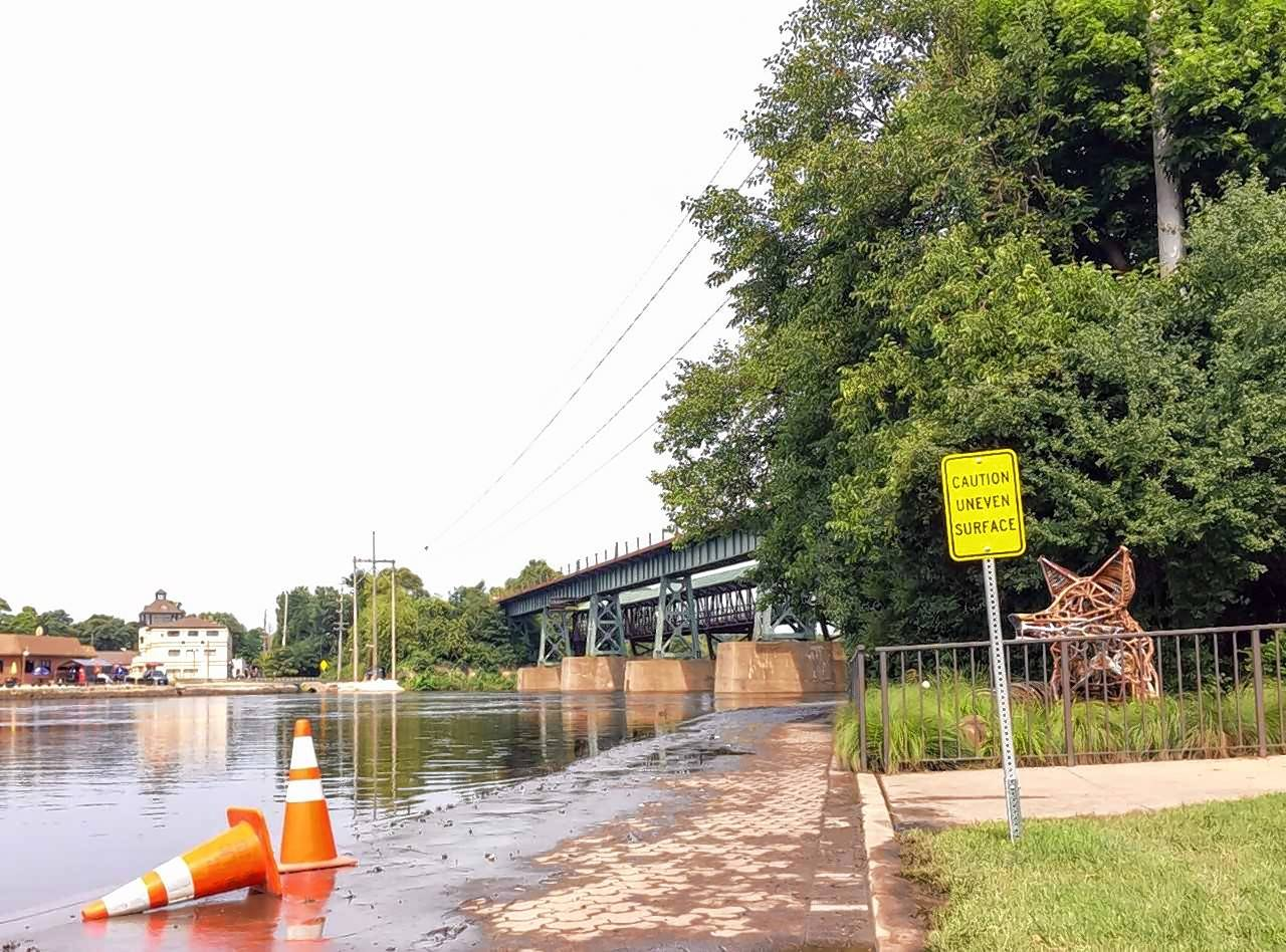 Flood Conditions In St. Charles Have The Fox River Overlapping Portions Of  The Course For
