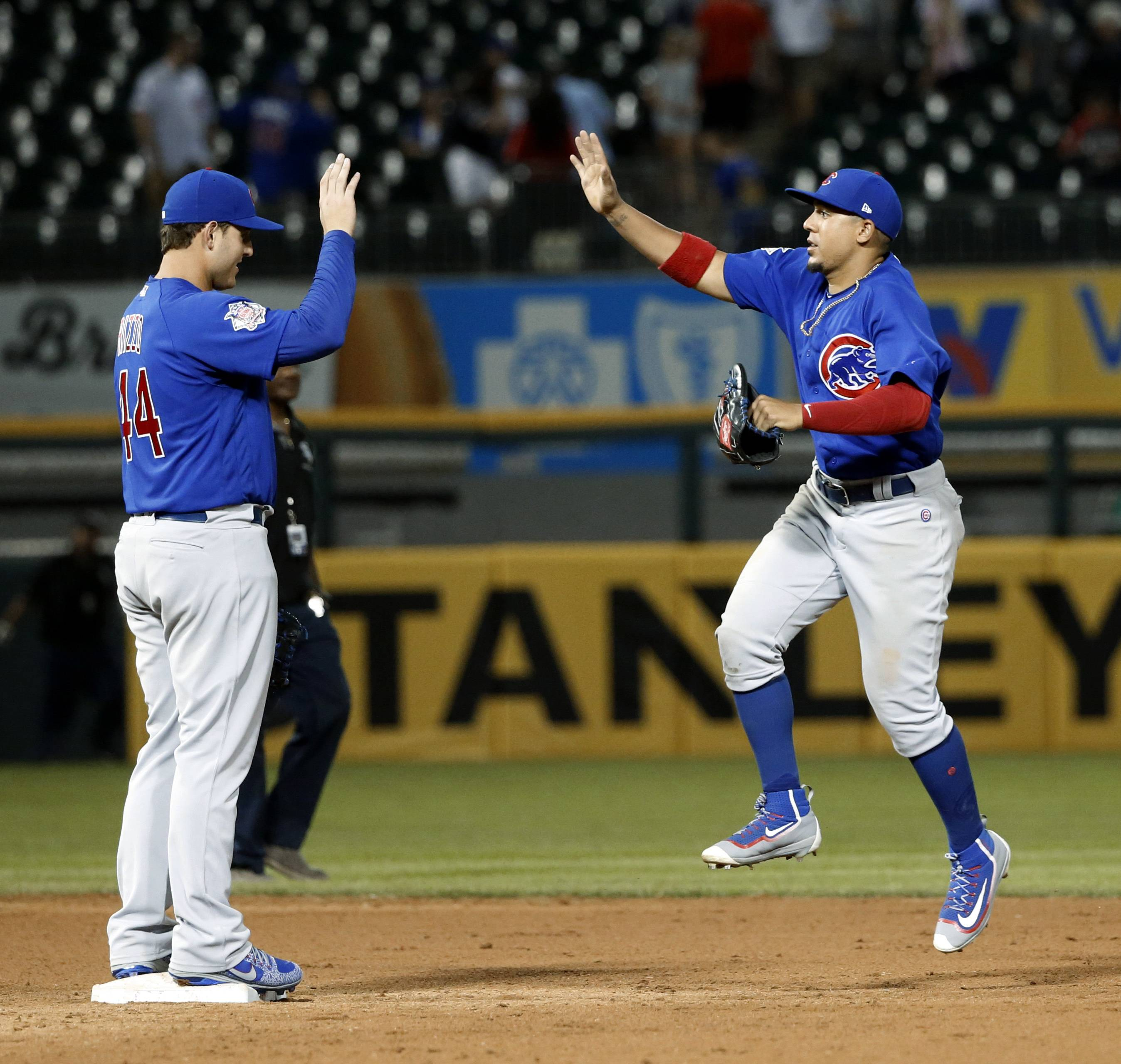 Chicago Cubs' Anthony Rizzo, left, and Jon Jay celebrate the team's 8-3 win over the Chicago White Sox in a baseball game Wednesday.