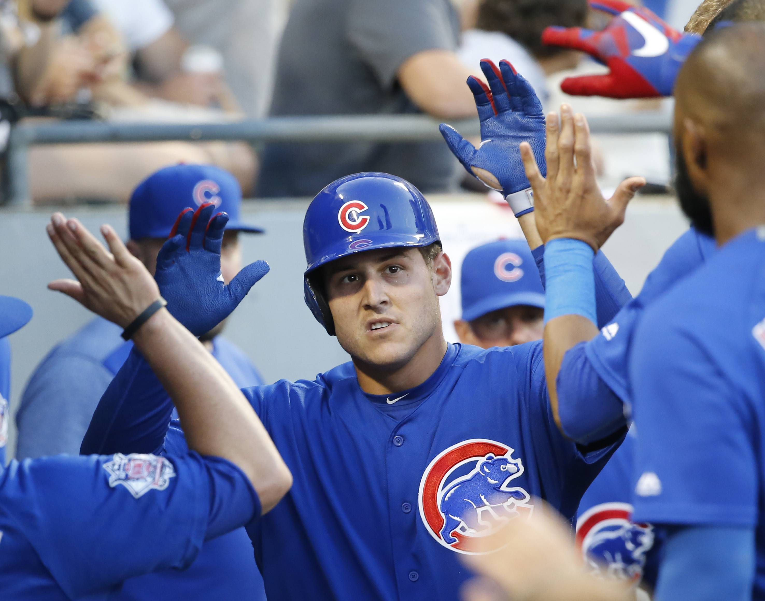Chicago Cubs' Anthony Rizzo celebrates in the dugout after his home run off Chicago White Sox starting pitcher Mike Pelfrey during the fourth inning of a baseball game Thursday, July 27, 2017, in Chicago.
