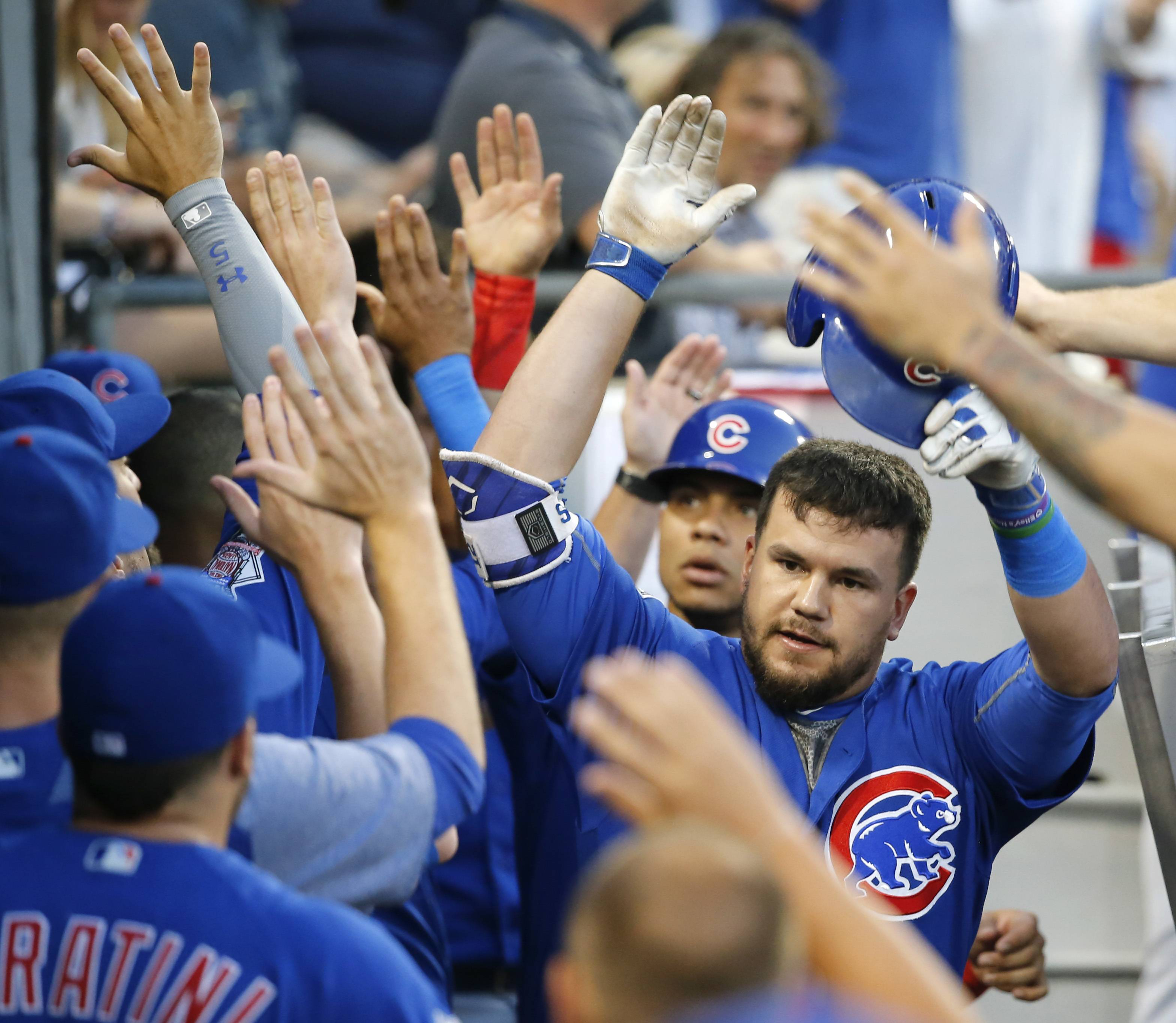 Cubs' Kyle Schwarber, right, and Willson Contreras, second from right, celebrate in the dugout after they scored on Schwarber's 2-run home run off Chicago White Sox starting pitcher Mike Pelfrey during the fourth inning Thursday, July 27, in Chicago. Things seem to be coming together at the right time for the Cubs as they head to Milwaukee this weekend for a three-game series with the Brewers. The Cubs beat the White Sox 6-3 Thursday night.