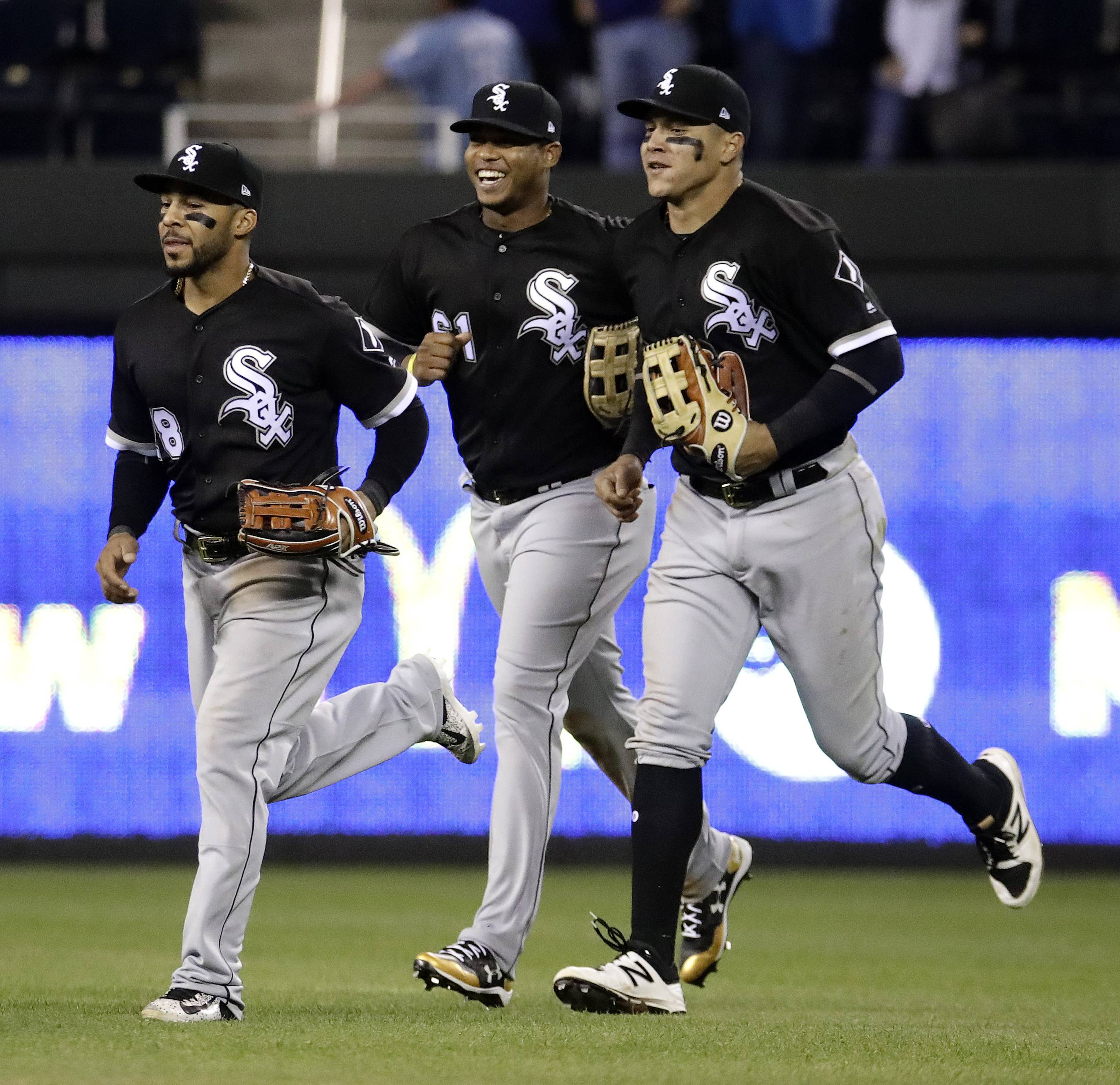 Chicago White Sox outfielder Willy Garcia, center, will replace Avisail Garcia, right, in tonight's lineup against the Cubs. That's Leury Garcia, at left, who is on a rehab assignment.