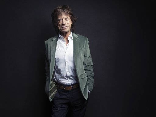 "FILE - In this Nov. 14, 2016 file photo, Mick Jagger of the Rolling Stones poses for a portrait in New York. Jagger released the songs and music videos Thursday, July 27, 2017, for tunes titled, ""Gotta Get a Grip� and ""England Lost.�  (Photo by Victoria Will/Invision/AP)"
