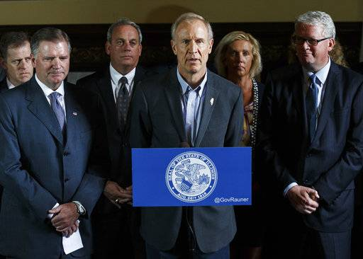 Illinois Governor Bruce Rauner, center, flanked by Republican members of both chambers speaks during a news conference during the second day of a special session on education funding at the Illinois State Capitol, Thursday, July 27, 2017, in Springfield, Ill. Rauner summoned lawmakers with the task of resolving a fight over a new funding calculation. Both chambers have approved a plan, but the Senate has refused to send it to Rauner, who says he'll rewrite it over objections to money that Chicago will get. (Justin L. Fowler/The State Journal-Register via AP)