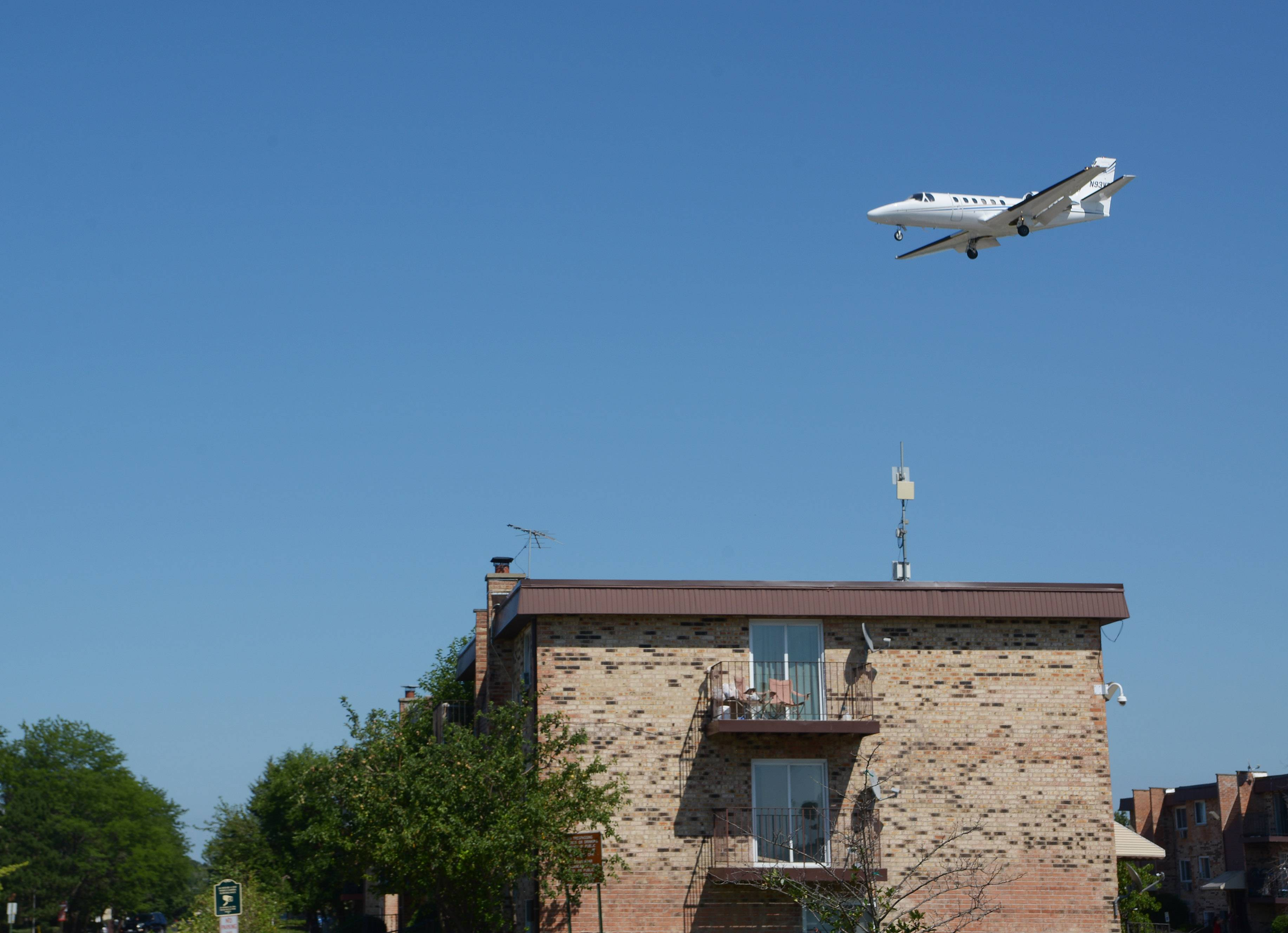 A jet passes over a Prospect Heights apartment complex before landing at Chicago Executive Airport.
