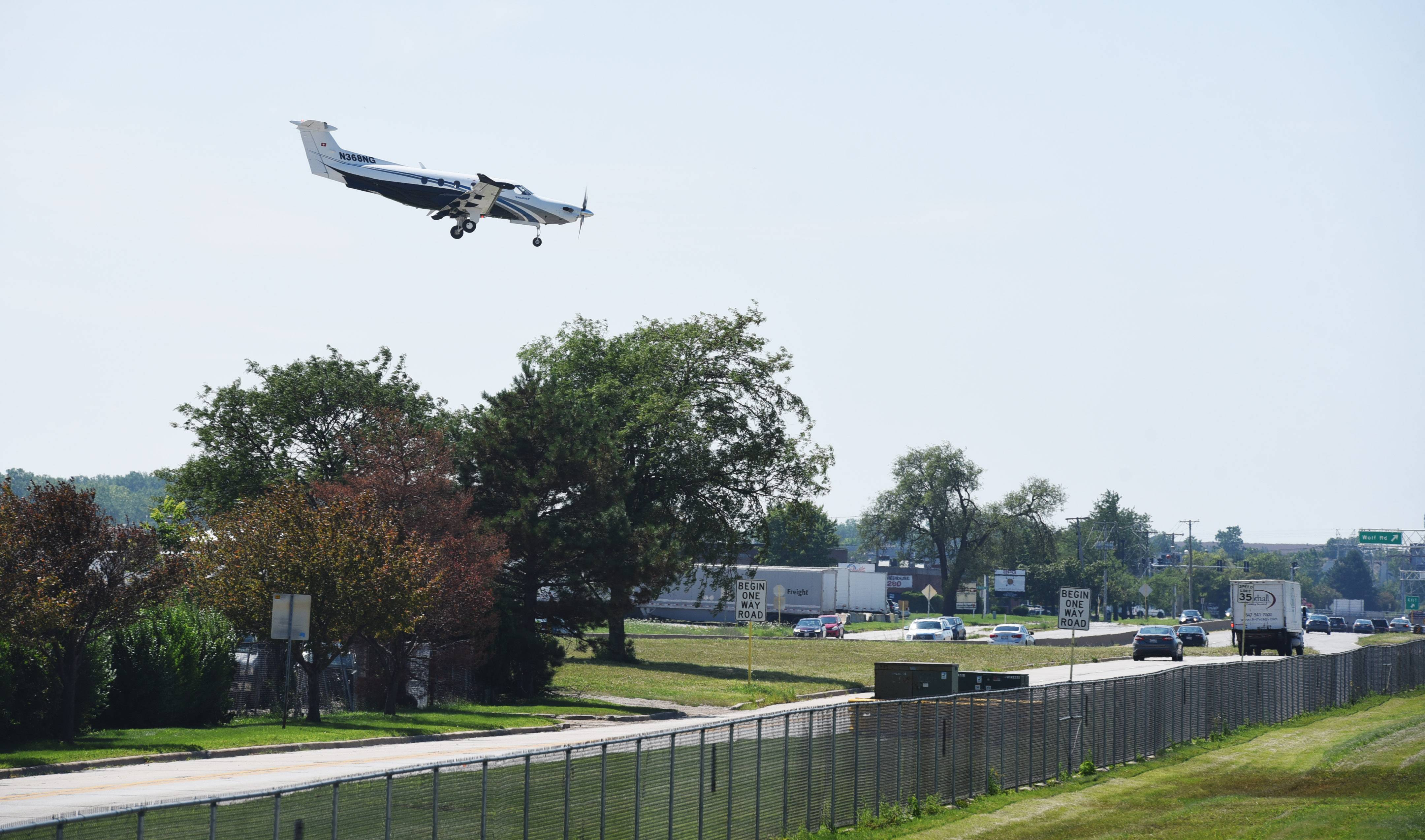 An aircraft passes over Willow/Palatine Road in Prospect Heights before landing at Chicago Executive Airport.