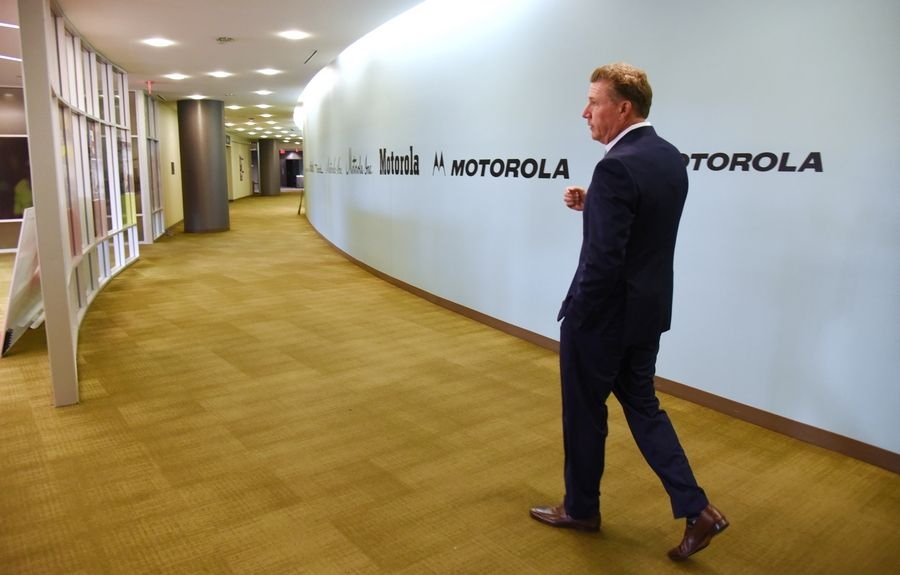 Bob Burk, managing partner of UrbanStreet Group LLC, walks through the halls of a former Motorola Solutions building in Schaumburg. The building will remain and be part of redevelopment project.