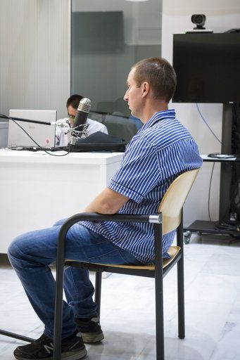 Pyotr Levashov, the Russian hacker arrested on April 7 in Barcelona, speaks during a hearing to consider his extradition to the United States, at the National Court in Madrid, Wednesday, July 26, 2017. Levashov's arrest was the latest in a series of American-initiated operations over the past year to seize alleged Russian cybercriminals outside their homeland, which has no extradition agreement with the United States. American-led operations have so far seized four Russian hackers outside their homeland over the past nine months. They come at a fraught moment in relations between Moscow and Washington, where politicians are grappling with the allegation that a Kremlin hacking campaign helped Donald Trump win the presidency. (Luca Piergiovanni/Pool Photo via AP)