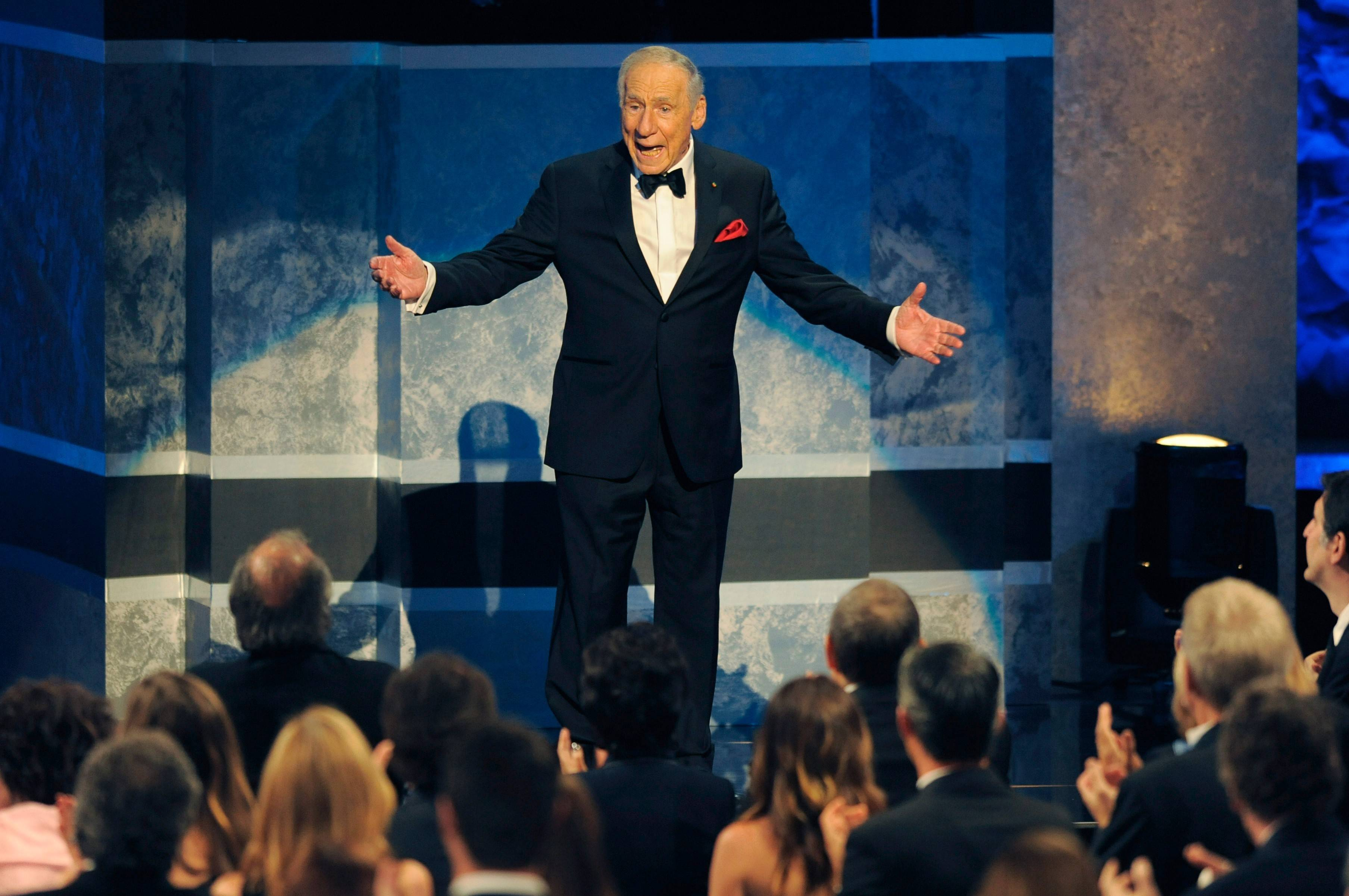 Honoree Mel Brooks greets the crowd as he arrives onstage for the American Film Institute's 41st Lifetime Achievement Award Gala at the Dolby Theatre on Thursday, June 6, 2013 in Los Angeles. (Photo by Chris Pizello/Invision/AP)