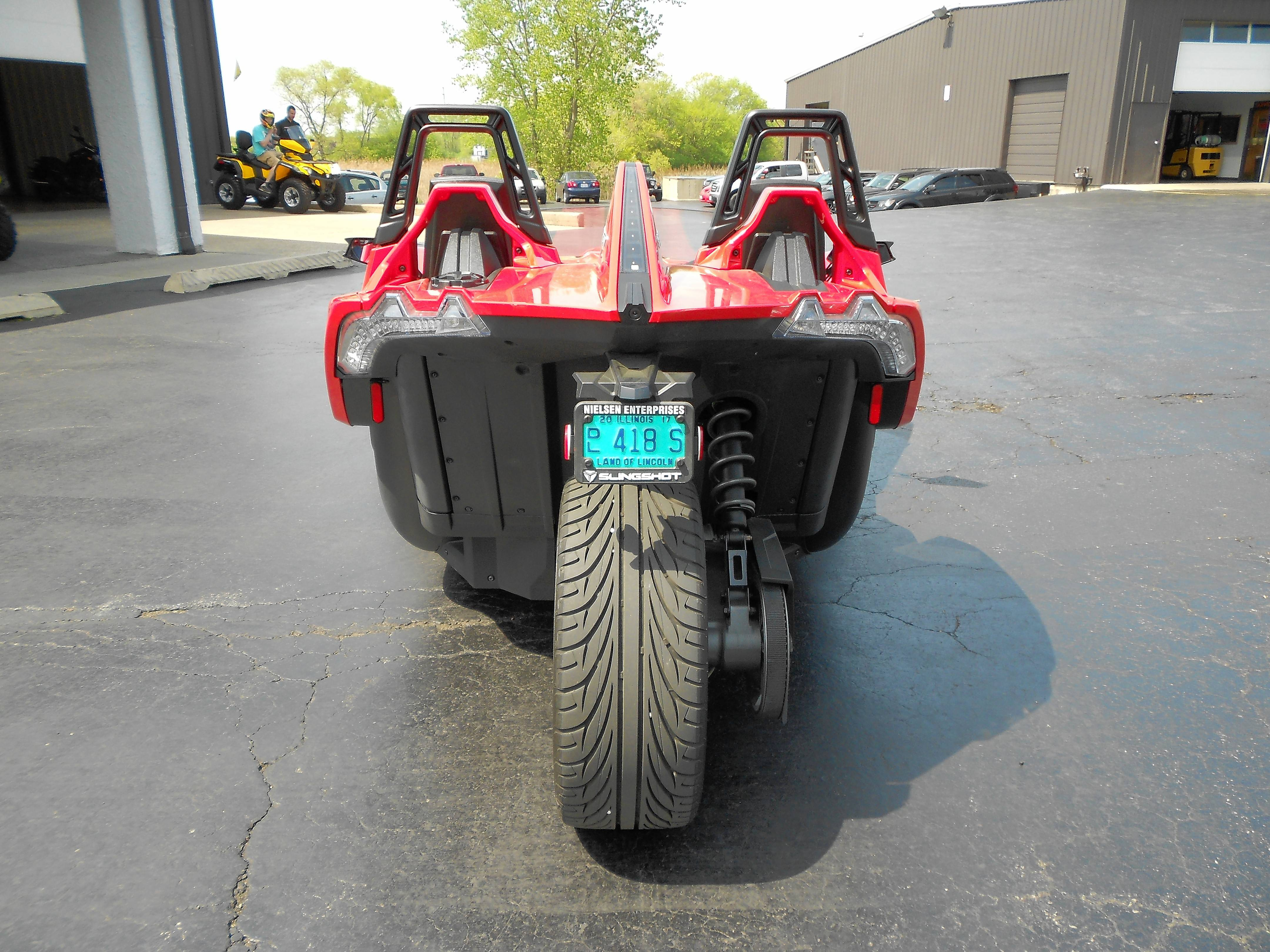 A big 265/35R-20 Kenda tire is found on the back of the three-wheel vehicle.