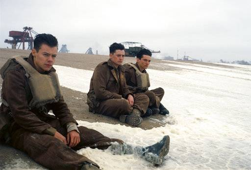 "Harry Styles, left, Aneurin Barnard and Fionn Whitehead star in ""Dunkirk."""