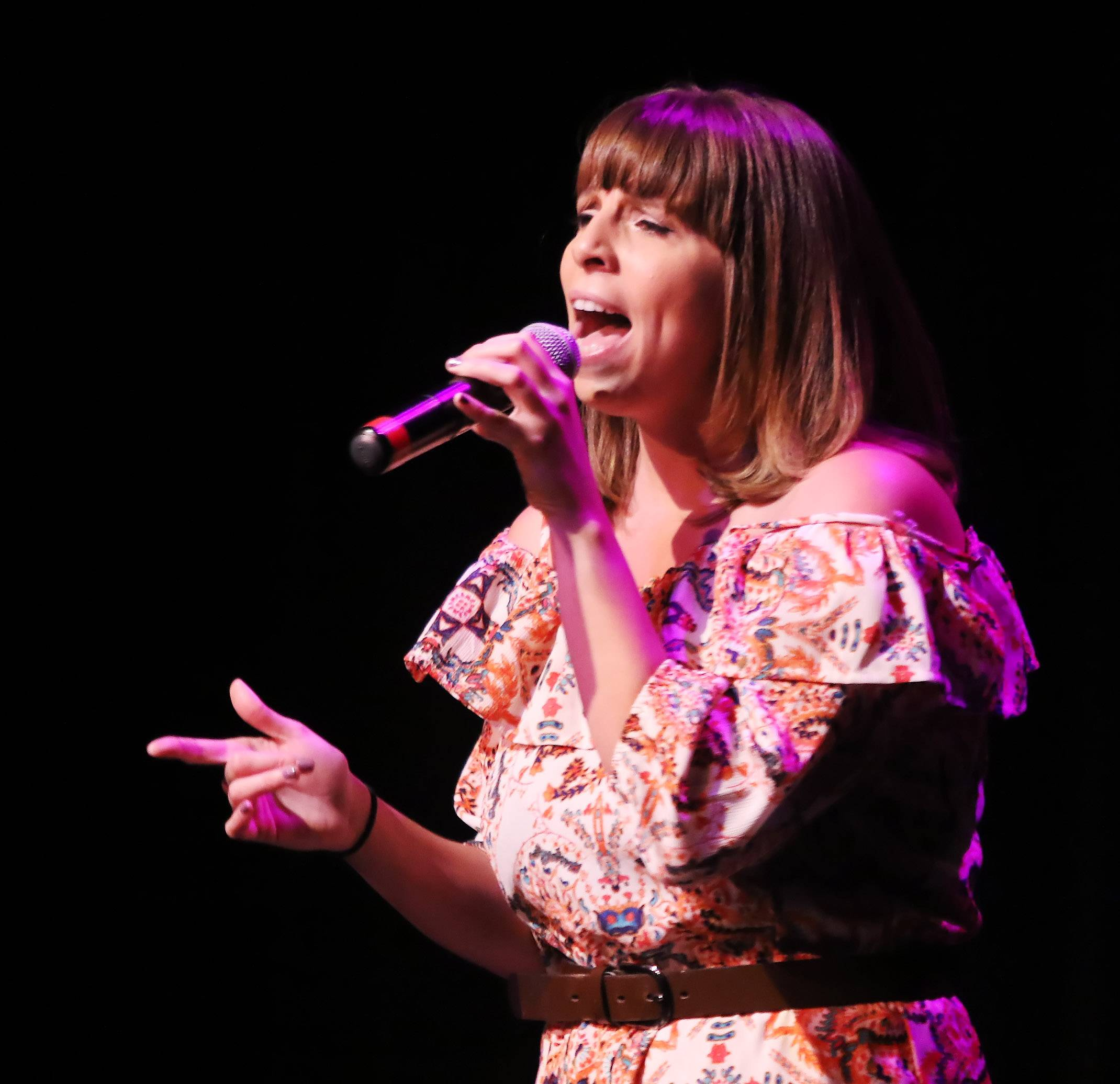 Cassandra Henwood of Elgin sings during the Suburban Chicago's Got Talent competition Sunday at Prairie Center for the Arts in Schaumburg. The winners will be announced at the Taste of Arlington Heights on Saturday, Aug. 5.