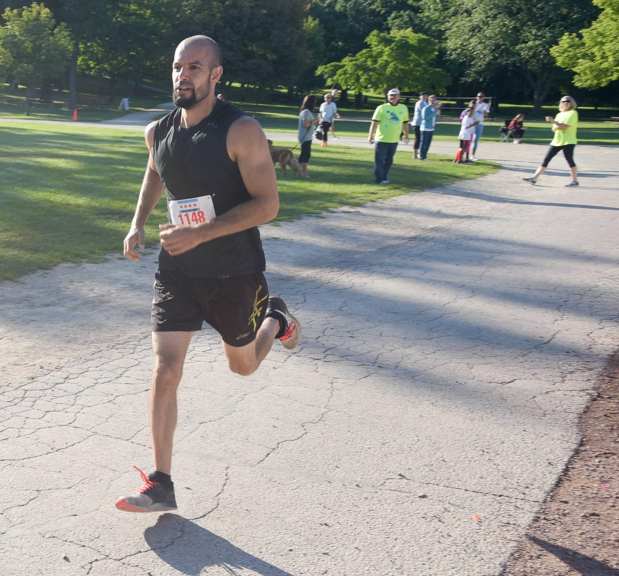 Dan Palmer of Rosco wins the Bob Leonard 5K River Run at Pottawatomie Park in St. Charles Sunday.