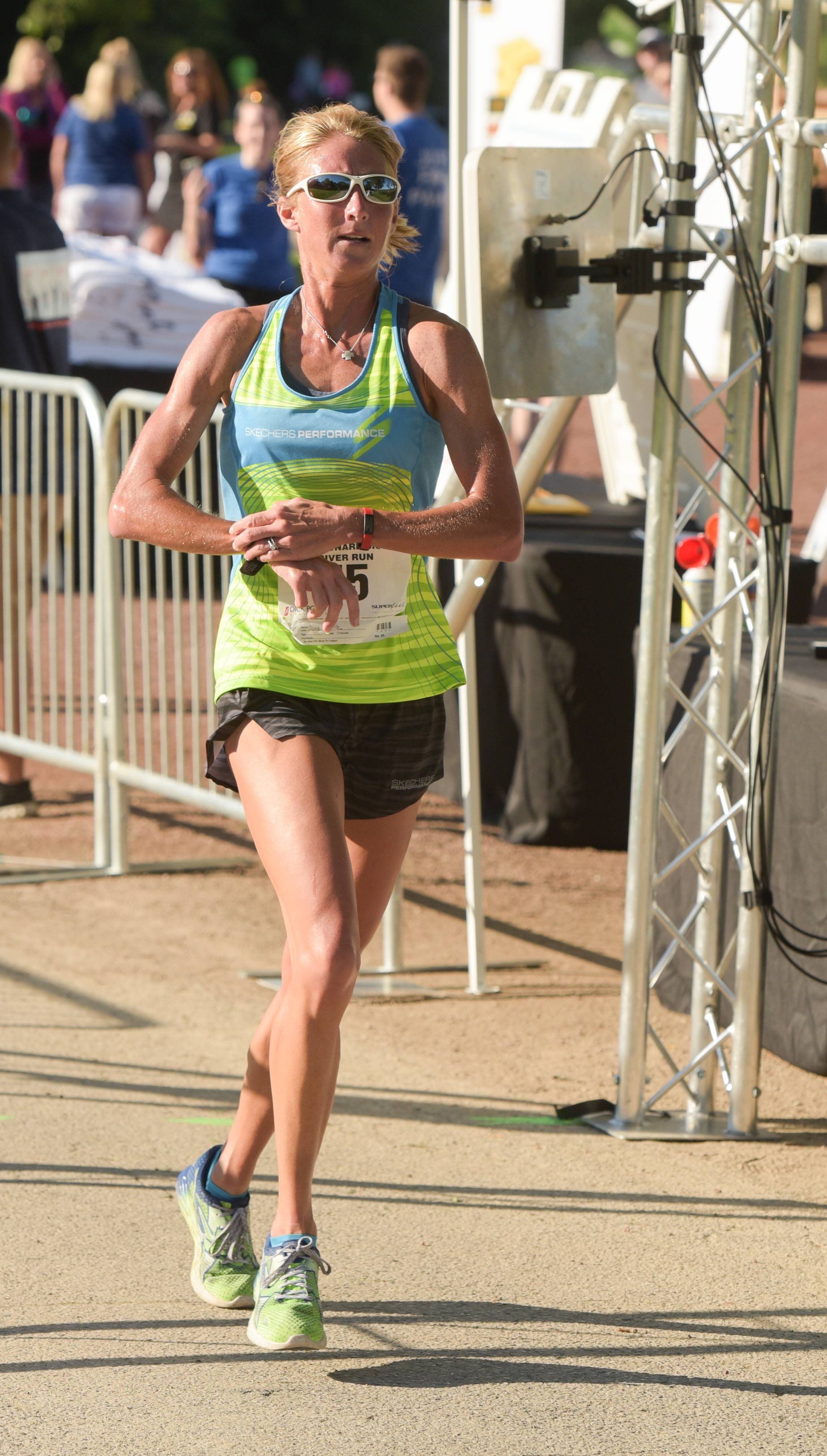 Carrie Birth-Davis of Scottsdale, Arizona, who grew up in St. Charles, was the first woman to cross the finish line in the Bob Leonard 5K River Run.