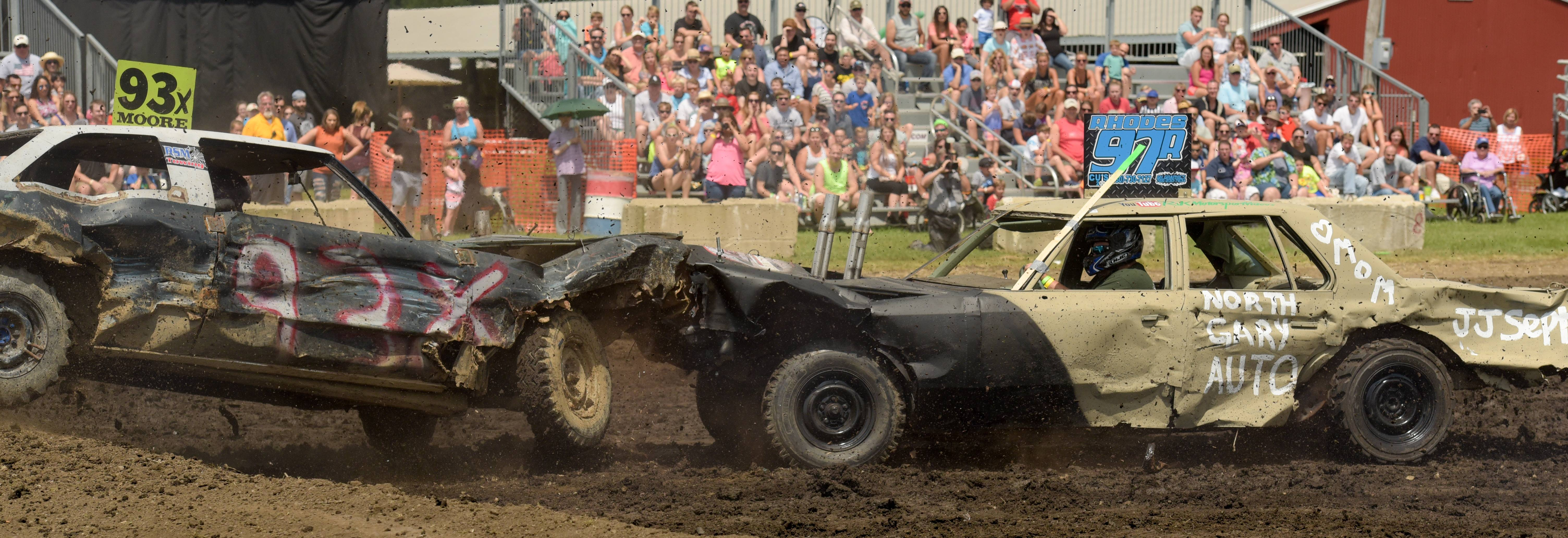 Vince Moore of Lombard is taken out of the game by Adkin Rhodes of St. Charles during the demolition derby at the DuPage County Fair on Sunday. Rhodes survived the demo and moved on to the finals.