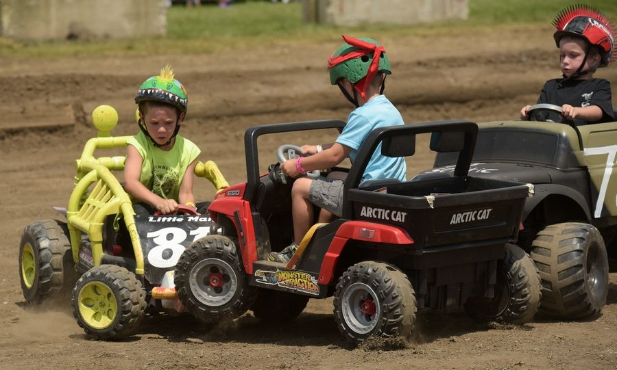 Tony Schnupp, 7 of Lee, Illinois, Jacob Poffenberger, 4, of Bolingbrook and Vince Cortino, 5, of Wheaton get in a three-way smashup during the power wheels demolition derby during the final day of the DuPage County Fair Sunday.
