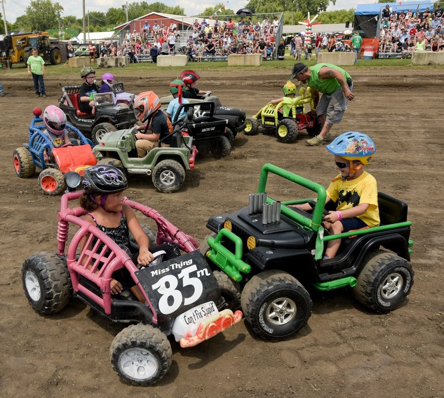 Future demolition derby drivers test their skills during the power wheels demolition derby Sunday at the DuPage County Fair.