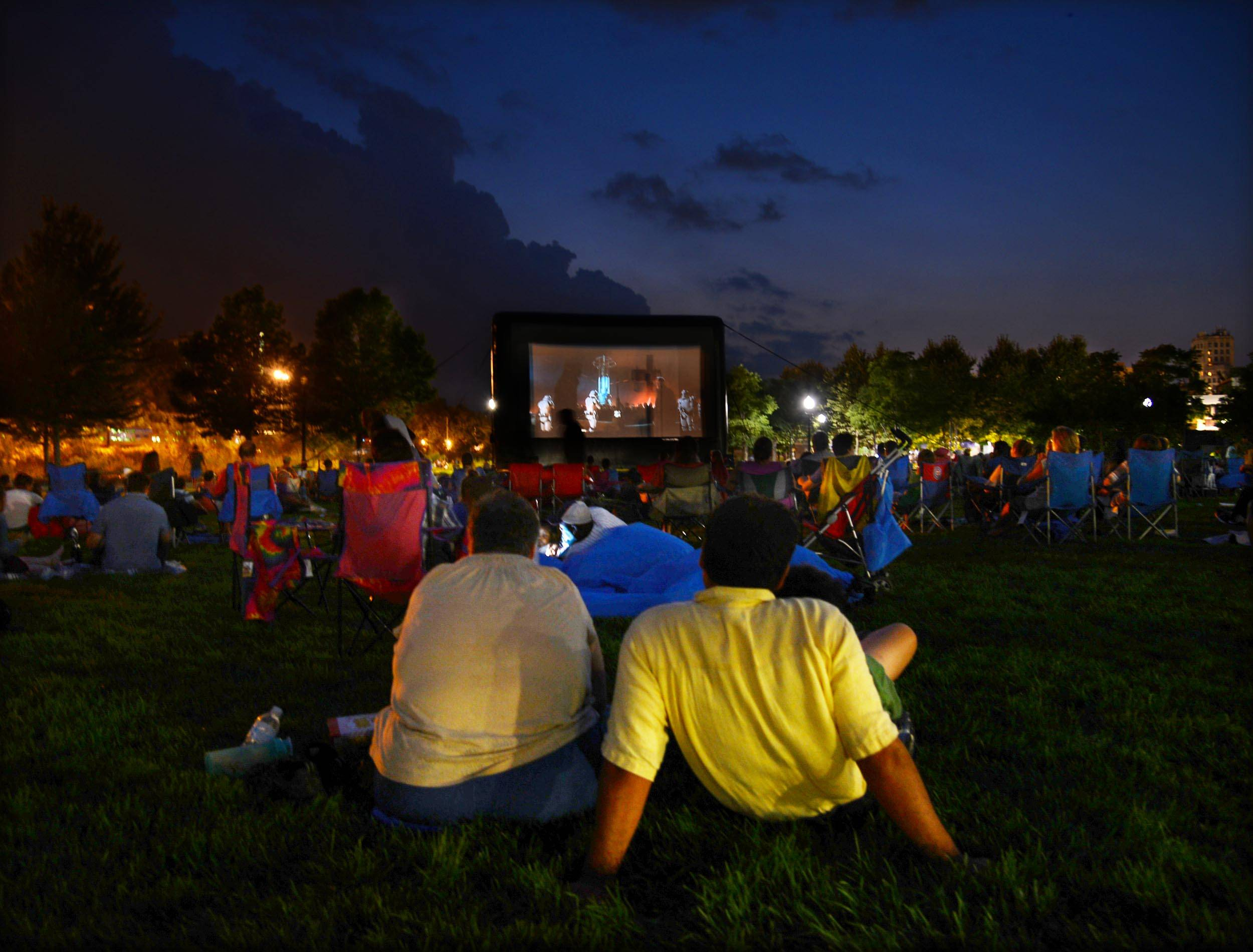 "Hundreds spread out on the lawn at last year's National Night Out event at Festival Park in Elgin to watch a movie. This year ""Jurassic World"" will be shown."