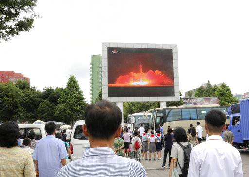 People watch a news broadcast on a missile launch in Pyongyang, North Korea, Saturday, July 29, 2017. North Korean leader Kim Jong Un said Saturday the second flight test of an intercontinental ballistic missile demonstrated his country can hit the U.S. mainland, hours after the launch left analysts concluding that a wide swath of the United States, including Los Angeles and Chicago, is now in range of North Korean weapons. (AP Photo/Jon Chol Jin)