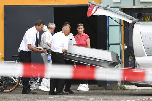 A coffin is carried in front of a discotheque in Constance, Germany, Sunday, July 30, 2017. A shooting in a German discotheque claimed two lives Sunday, including that of the gunman, and wounded four people, three of them seriously, police said. (Felix Kaestle/dpa via AP)