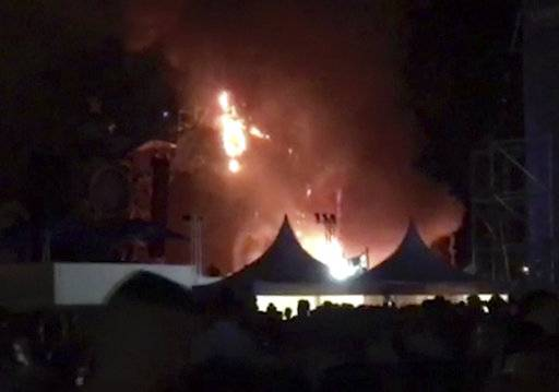 "In this image made from video provided by David Belmonte, flames engulf the outdoor stage during the ""Tomorrowland"" electronic music festival in Barcelona, Spain, Saturday night, July 29, 2017. A spectacular fire at the music festival forced the evacuation of over 20,000 concertgoers, the regional government says. (David Belmonte via AP)"