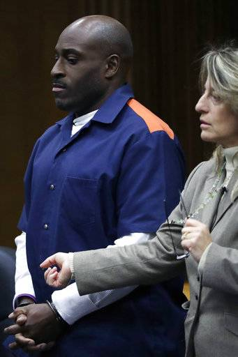 "In this Thursday, March 16, 2017 photo, Bobby Hines, with his attorney Valerie Newman, stand before Judge Cynthia Gray Hathaway during a resentencing hearing in Detroit for the 1989 murder of James Warren. ""As a man, I take full ownership for what I did,"" he tells the judge. ""I tore their family up, and I didn't even realize what I was doing."""