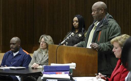"In this Thursday, March 16, 2017 image made from video, Henry Carpenter Warren Jr. addresses the court during a resentencing hearing for his son's killer, Bobby Hines, seated left, at the Frank Murphy Hall of Justice in Detroit. Warren says Hines ""was punished excessively. ... He can go home today."""