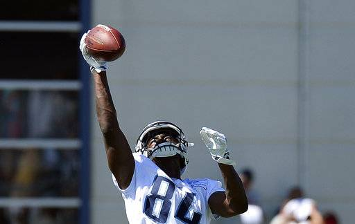 Tennessee Titans wide receiver Corey Davis catches a pass during NFL football training camp Sunday, July 30, 2017, in Nashville, Tenn. (AP Photo/Mark Zaleski)