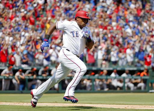 Texas Rangers' Adrian Beltre sprints around first to second after hitting for a double off a pitch from Baltimore Orioles' Wade Miley in the fourth inning of a baseball game, Sunday, July 30, 2017, in Arlington, Texas. The double was Beltre's 3,000th career hit. (AP Photo/Tony Gutierrez)