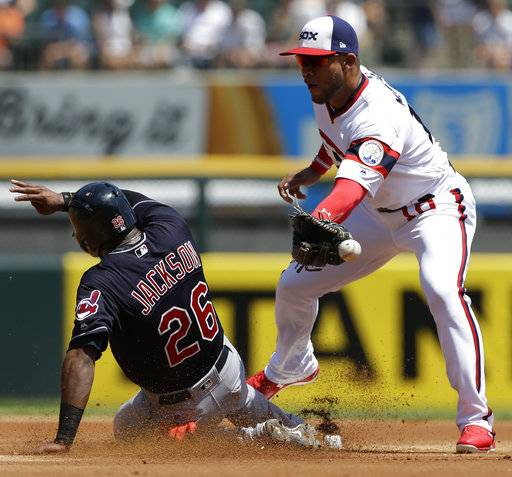 Cleveland Indians' Austin Jackson, left, steals second base as Chicago White Sox second baseman Yoan Moncada misses the ball during the first inning of a baseball game Sunday, July 30, 2017, in Chicago. (AP Photo/Nam Y. Huh)