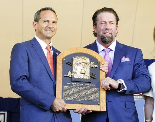 Hall of Fame president Jeff Idelson, left, presents National Baseball Hall of Fame inductee Jeff Bagwell with his Hall of Fame plaque during an induction ceremony at the Clark Sports Center, Sunday, July 30, 2017, in Cooperstown, N.Y. (AP Photo/Hans Pennink)