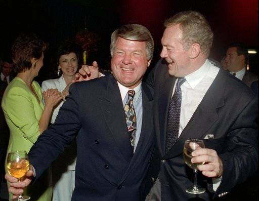 FILE - In this Feb. 1, 1993, file photo, Dallas Cowboys coach Jimmy Johnson, left, and team owner Jerry Jones smile at a team party in Santa Monica, Calif., after winning Super Bowl 27 against the Buffalo Bills. Jones fired Johnson in 1994 after the team had won two consecutive Super Bowls. (AP Photo/Ron Heflin, File)