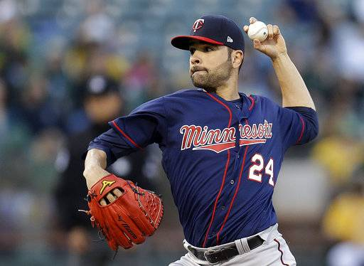 File- This photo taken July 28, 2017, shows Minnesota Twins pitcher Jaime García working against the Oakland Athletics during the first inning of a baseball game in Oakland, Calif. The Yankees bolstered their rotation a day before the non-waiver trade deadline as they acquired García from the Minnesota Twins for a pair of minor league pitchers. (AP Photo/Ben Margot, File)