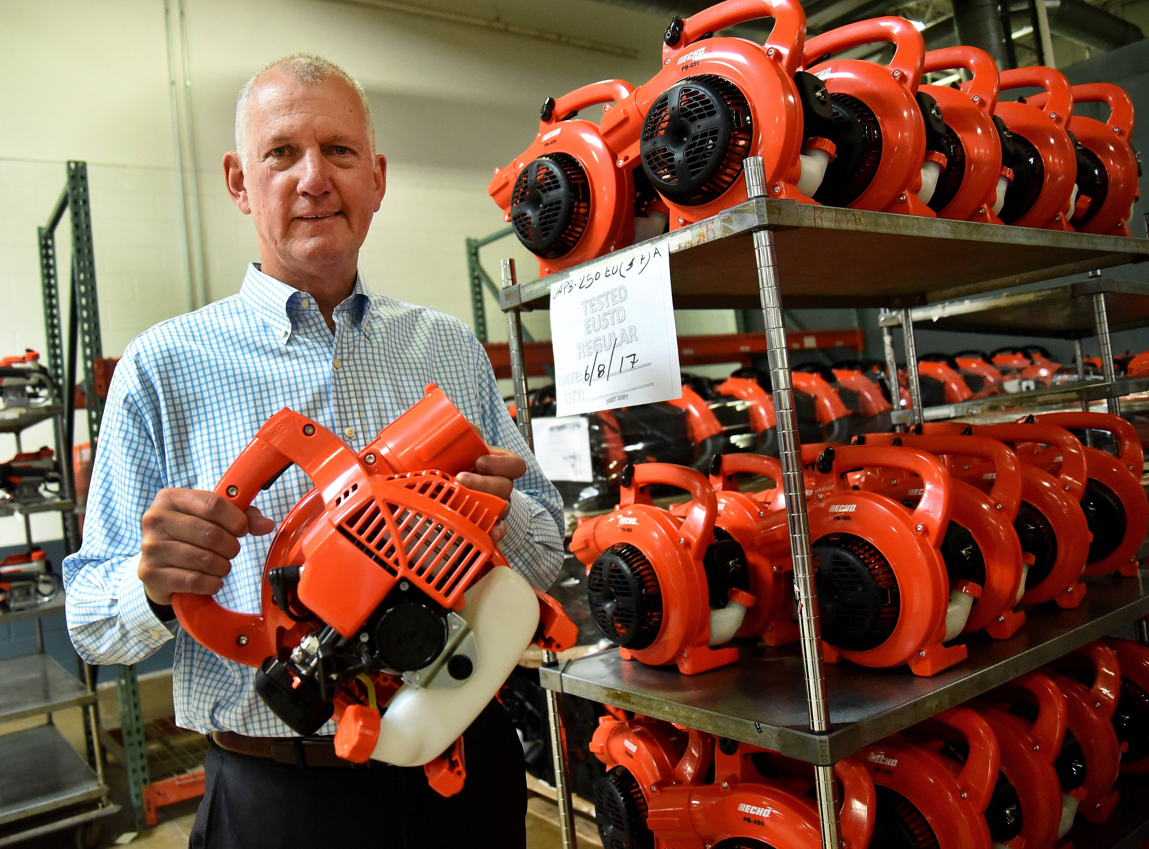 Tim Dorsey, company president of Echo Inc. in Lake Zurich, holds one of the company's leaf blowers.