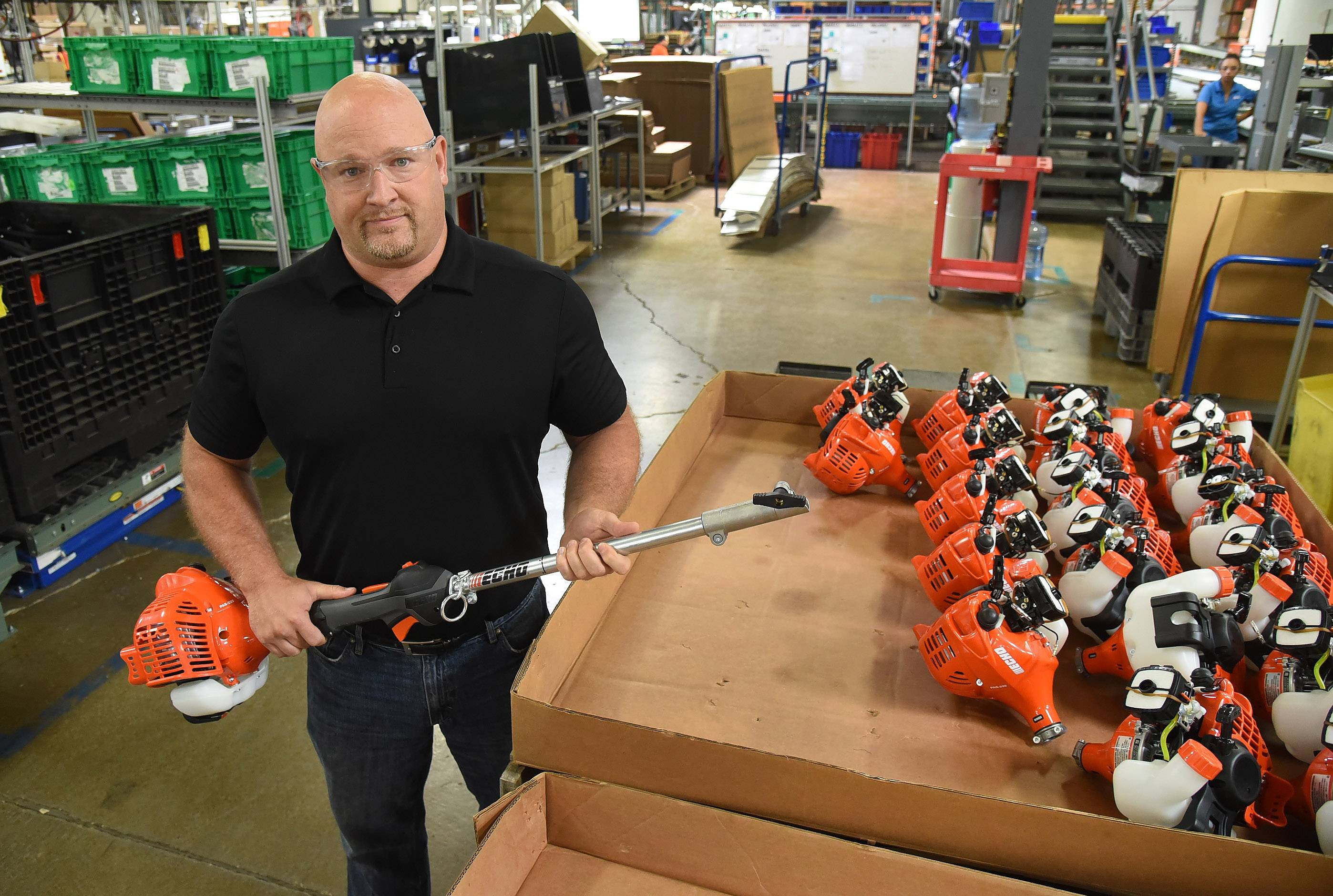 Ryan Ladley, senior director of operations, holds a PAS 225, from the pro attachment series, all purpose trimmer, edger and blower, at Echo Inc. in Lake Zurich.