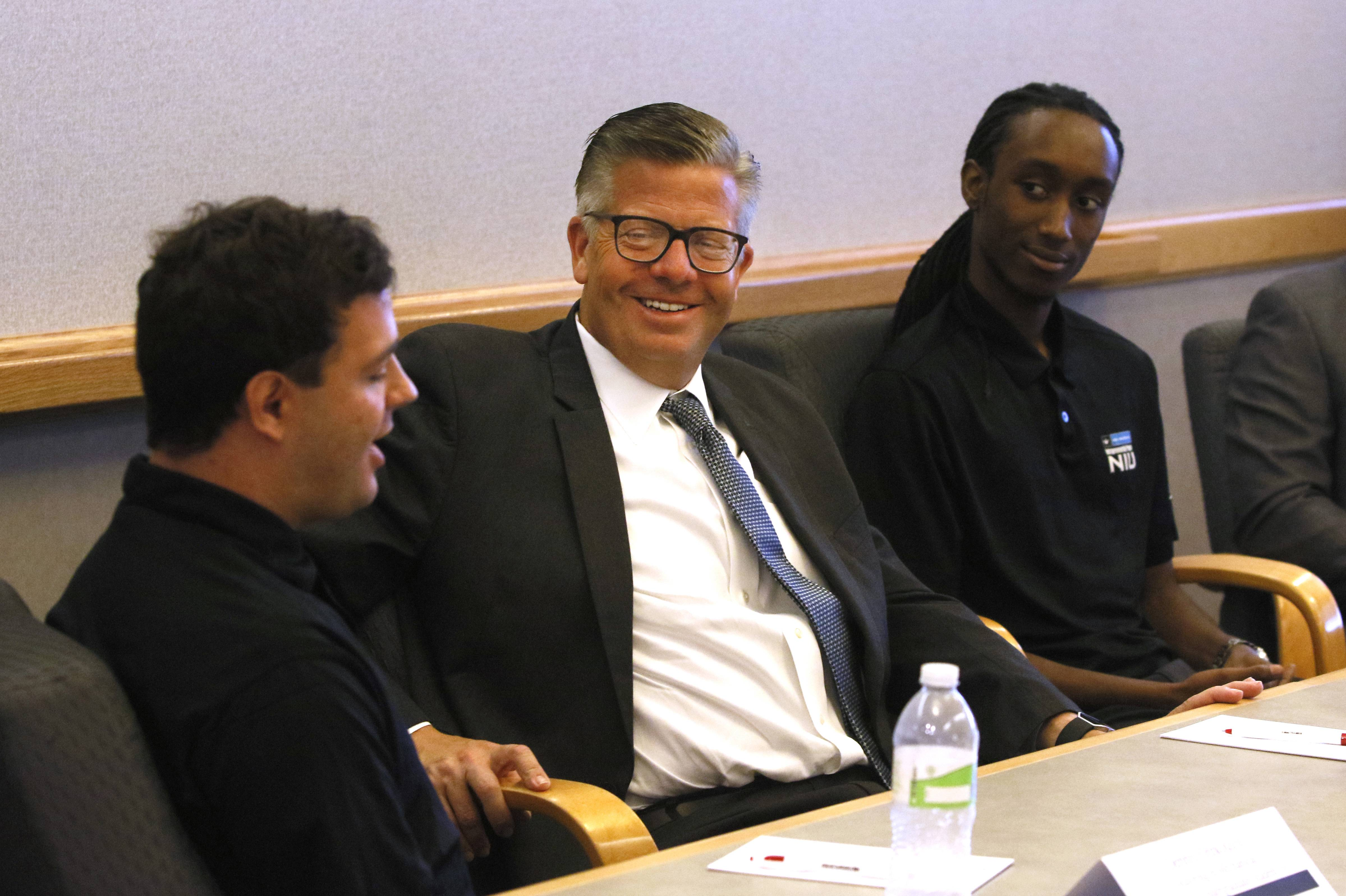 "U.S. Rep. Randy Hultgren talks business with Northern Illinois University students Dennis Grekousis and Malik Hughes, who are in an ""intrapreneurship"" program that lets them develop a new business idea while working as interns for the technology company Ideal Industries in Sycamore."