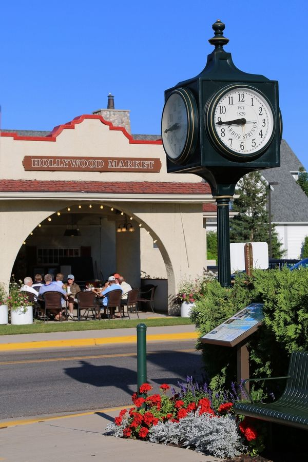 Visitors enjoy shopping and dining in downtown Harbor Springs, Michigan. Fast-food restaurants are banned in the affluent community.