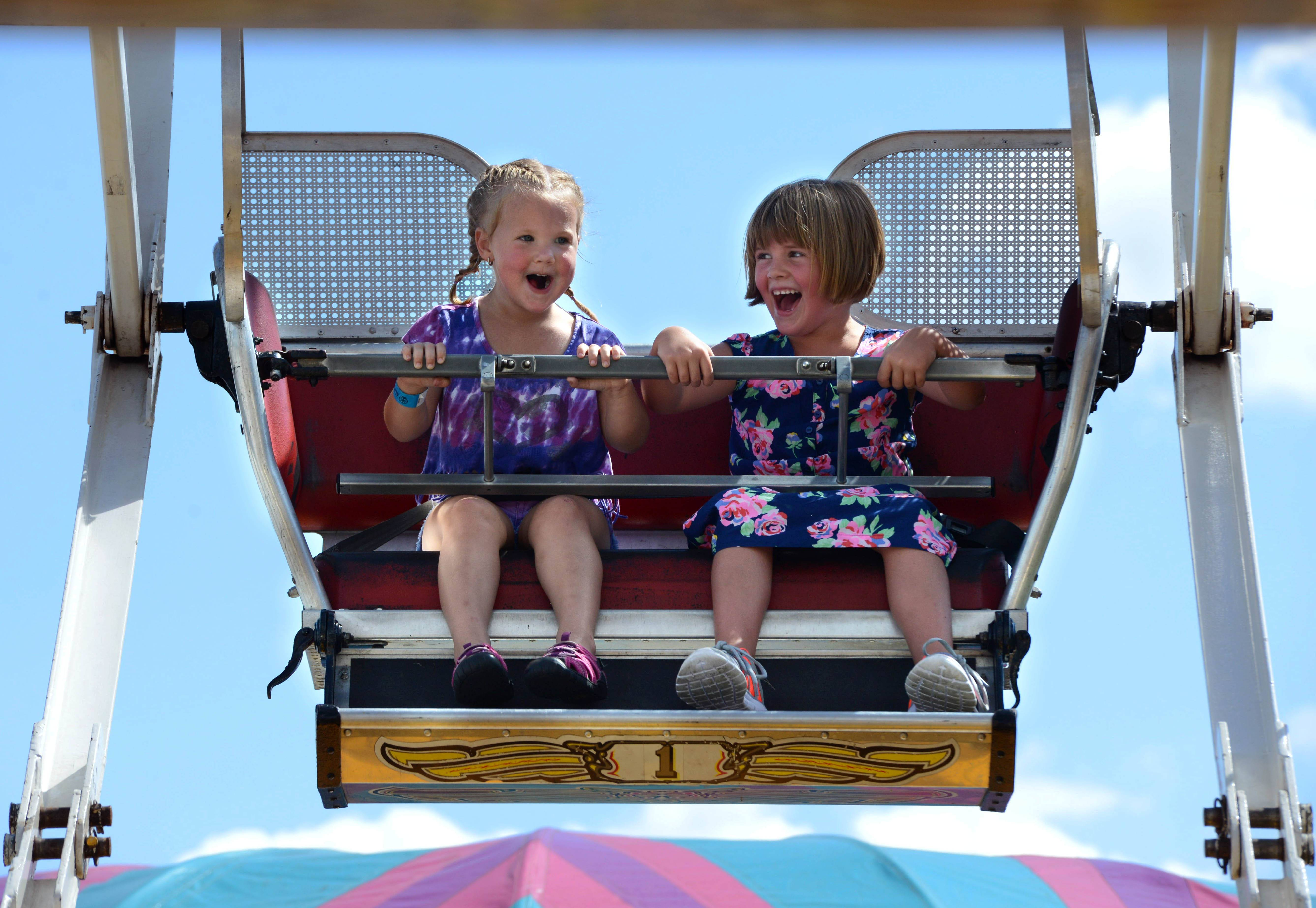 Cousins Sophia Mellville, 3, of Sycamore and Mazy Nelson, 5, of Carpentersville love their Ferris wheel ride at last year's Coon Creek Country Days in Hampshire.