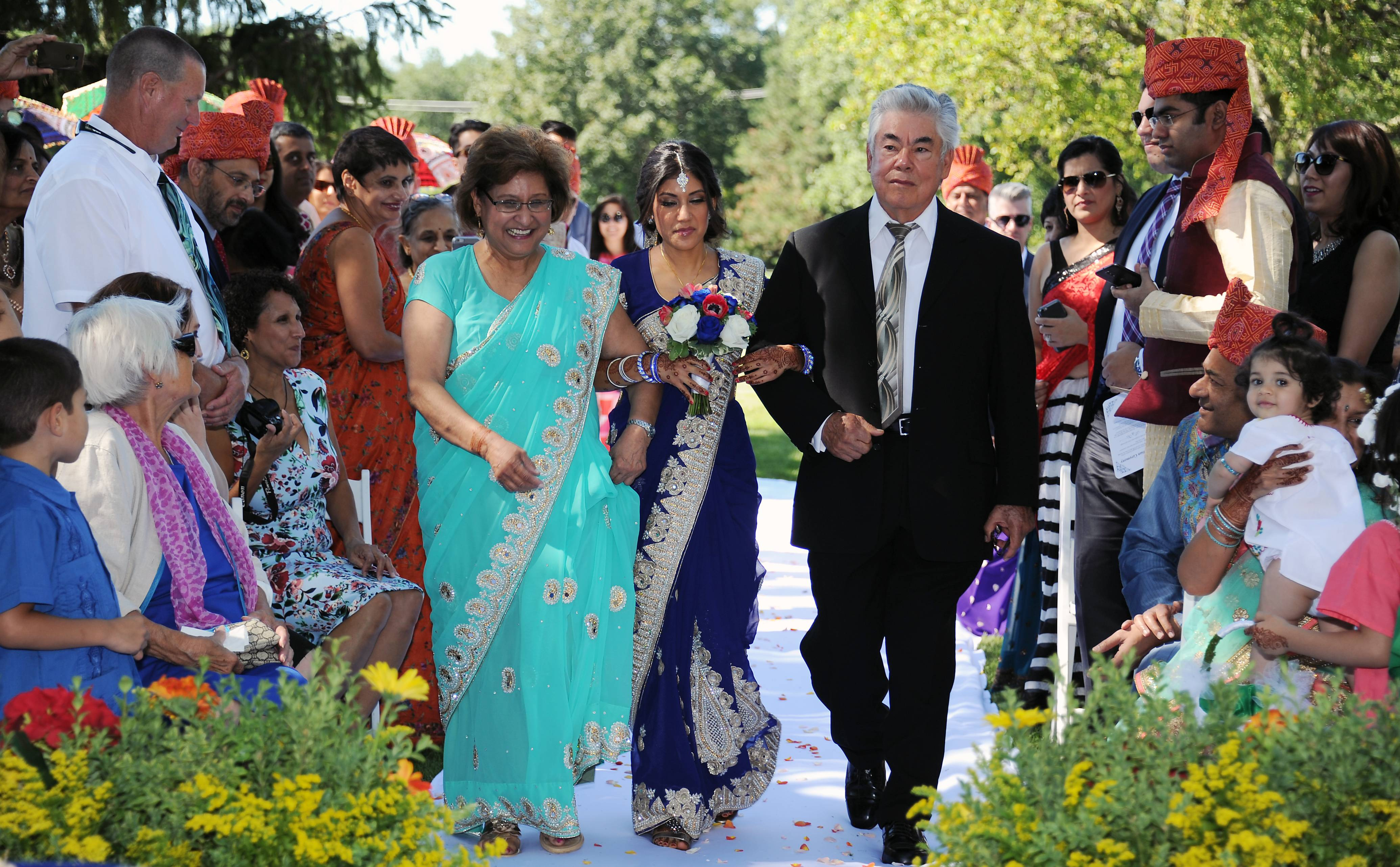 Veronica Garcia was escorted up the aisle by her parents, Ruth and Antonio Garcia, in a wedding that combined Indian, Mexican and American traditions.
