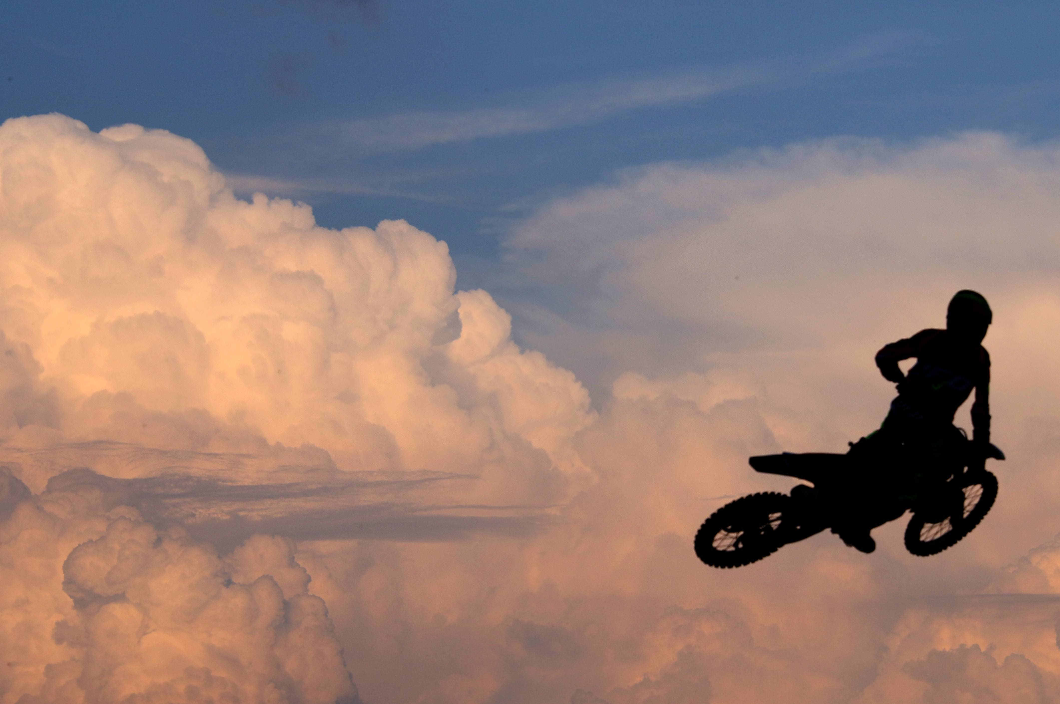 A racer soars during Woodstock MX Motocross Racing at the grandstand Thursday night at the McHenry County Fair in Woodstock. The fair continues through Sunday.