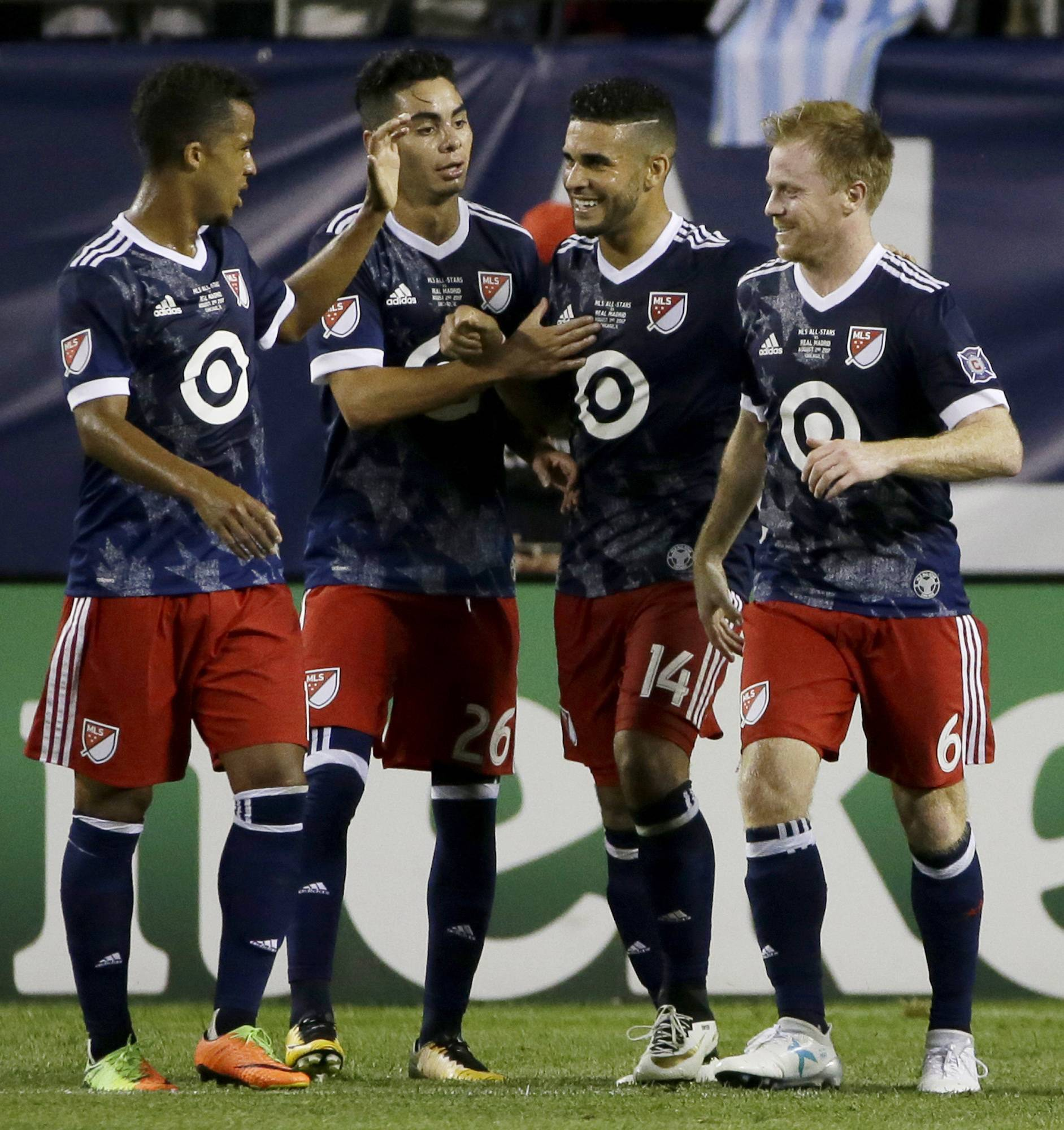 MLS All-Stars' Dom Dwyer (14) celebrates with teammates, including Chicago Fire midfielder Dax McCarty at right, after scoring against Real Madrid during the second half of the MLS All-Star Game, Wednesday in Chicago. Real Madrid won 4-2 in a penalty shootout.