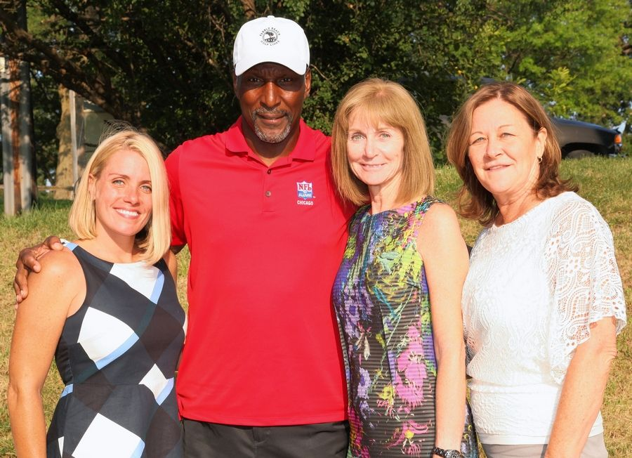Meghan Moreno, left, executive director, Edward Foundation: former Chicago Bear Otis Wilson; Mary Lou Mastro, system CEO, Edward-Elmhurst Health; and Marianne Spencer, chief operating officer, Edward Hospital, at the Edward Foundation's Annual Charity Golf Tournament at Cog Hill Golf & Country Club in Lemont.