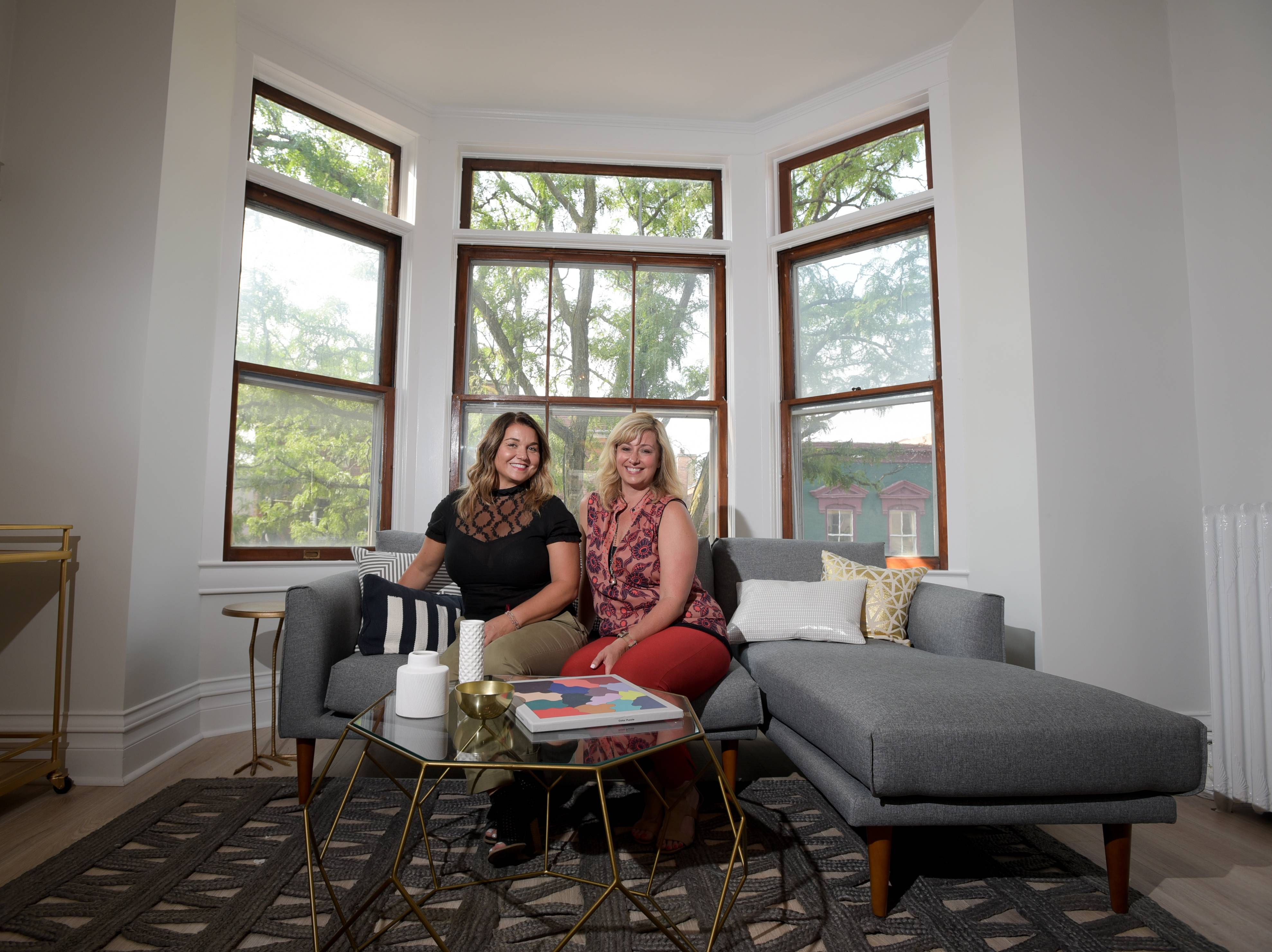 Stacy Amoo-Mensah and Heather DeMonte run their business, a branding boutique called Klique Creative, out of a co-working space they opened in April above Costello Jewelers in downtown Naperville.