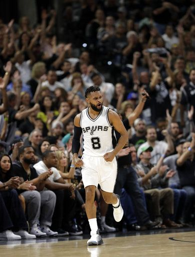 FILE - In this May 3, 2017, file photo, San Antonio Spurs guard Patty Mills celebrates sinking a three-point basket against the Houston Rockets during Game 2 in a second-round NBA basketball playoff series, in San Antonio. The Spurs have re-signed reserve guard Patty Mills, who shot 41 percent from 3-point range last season. The Spurs announced the deal Friday, Aug. 4, 2017, though details of the contract were not disclosed per team policy.