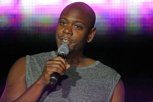 FILE - This Sunday, July 6, 2014 file photo, Dave Chappelle performs at the Essence Festival in New Orleans.  As Dave Chappelle reflects on spending 30 years in comedy, he says he's grateful and humble to still be living his dreams onstage. The 43-year-old kicked off a residency this week, Saturday, Aug. 5, 2017,  at Radio City Music Hall in New York.