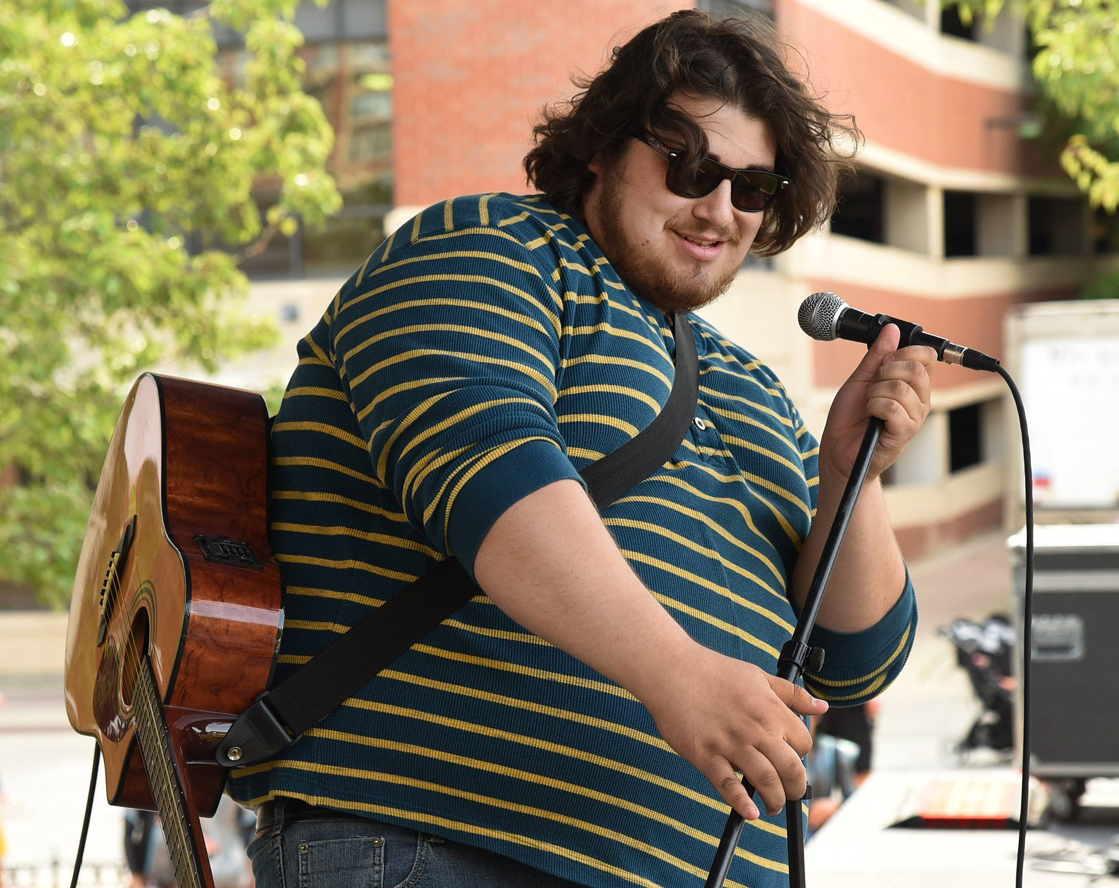 "Lorenzo Esposito of Lisle performed Glen Hansard's ""Leave"" at the 2017 finale of Suburban Chicago's Got Talent on Saturday at the Taste of Arlington Heights."