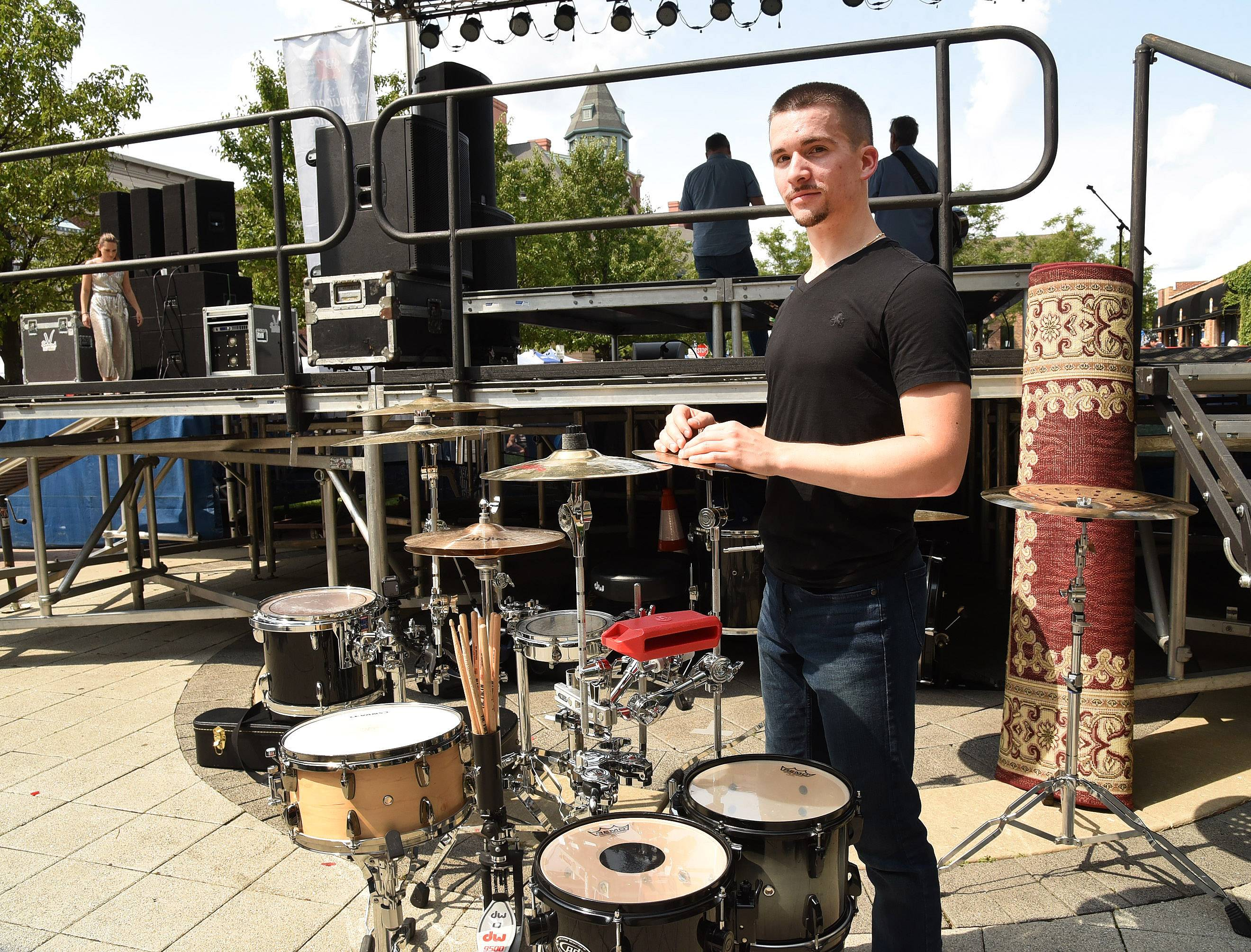 Adrian Guzik of Berwyn was the first drum soloist to make it to the top 10 of Suburban Chicago's Got Talent. He performed to a mashup of pop and heavy metal hits at the competition finale Saturday at the Taste of Arlington Heights.